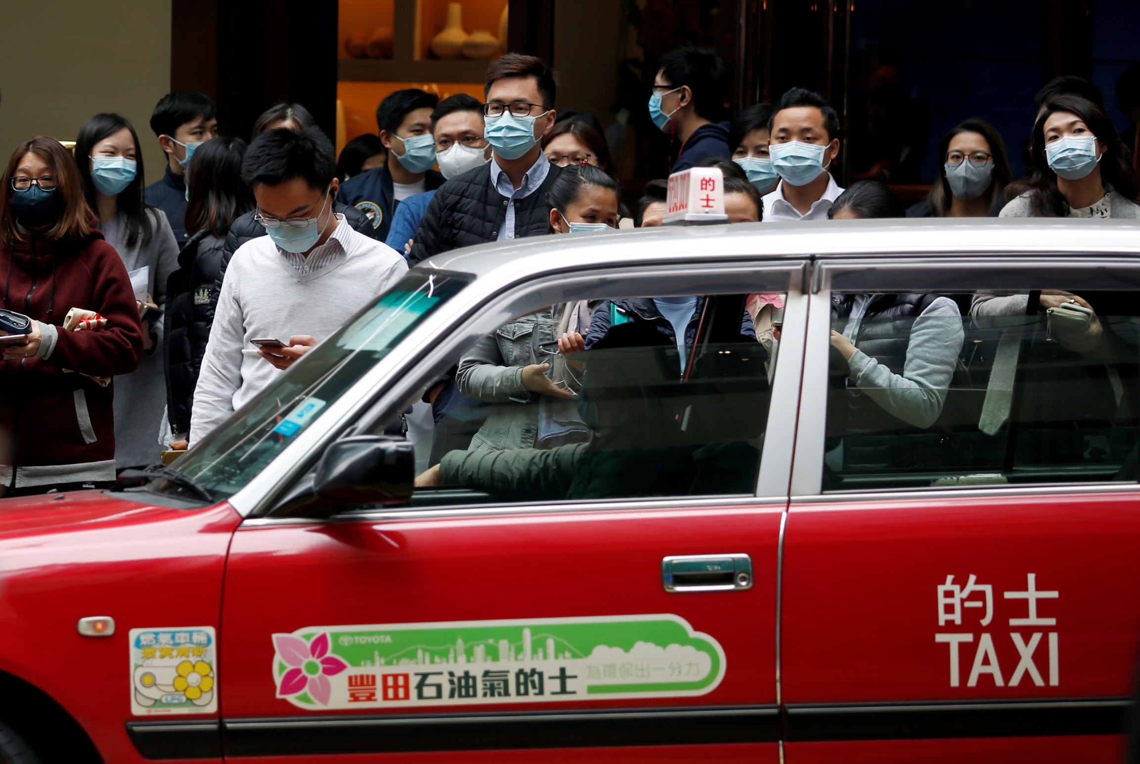 People wear masks on crowded street in Hong Kong