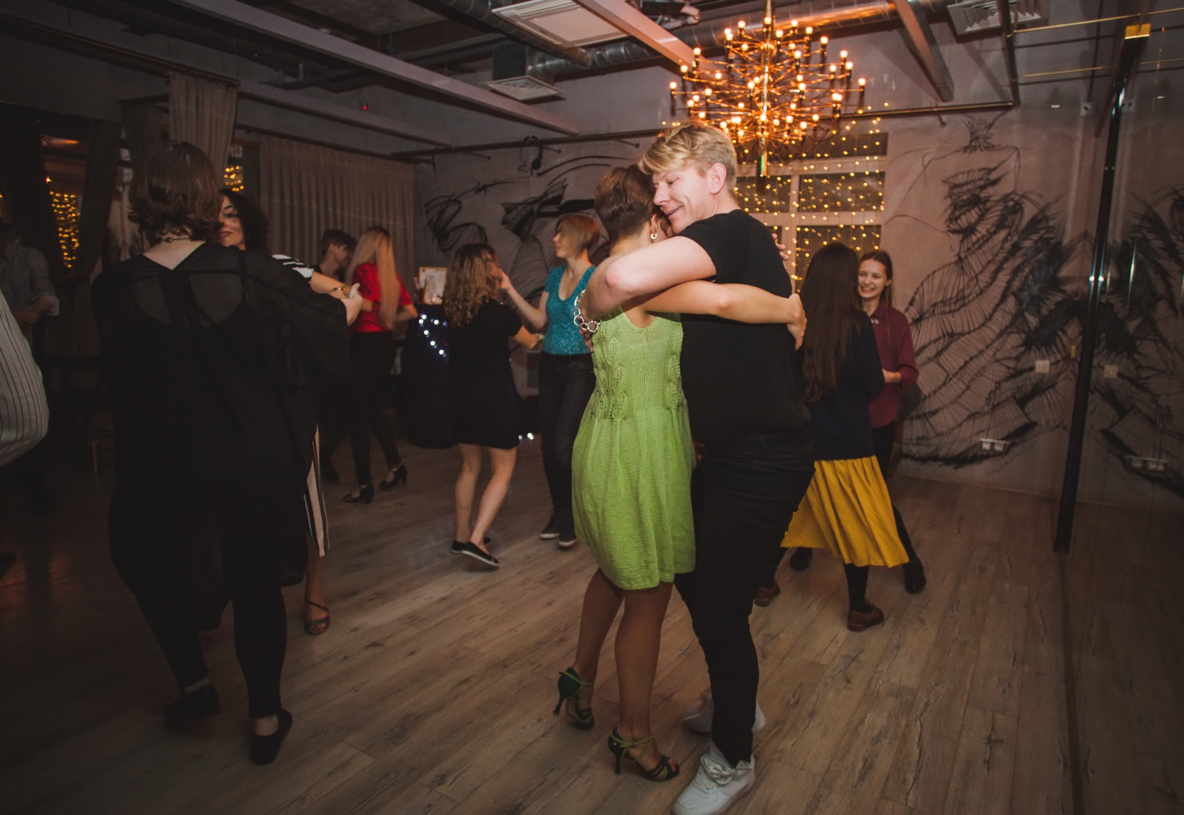 Couples dance together at a dance festival