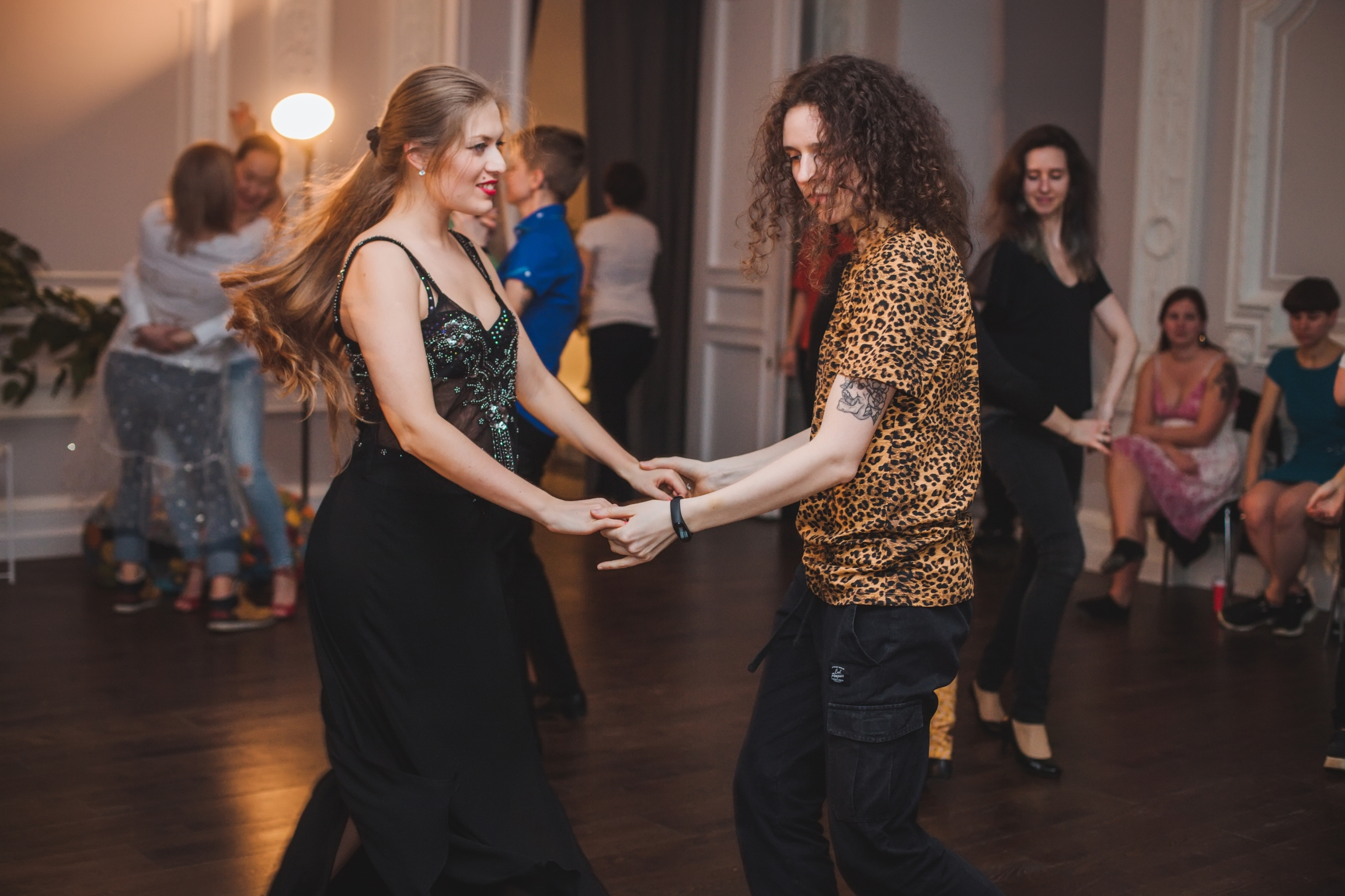 Two people dance at a studio