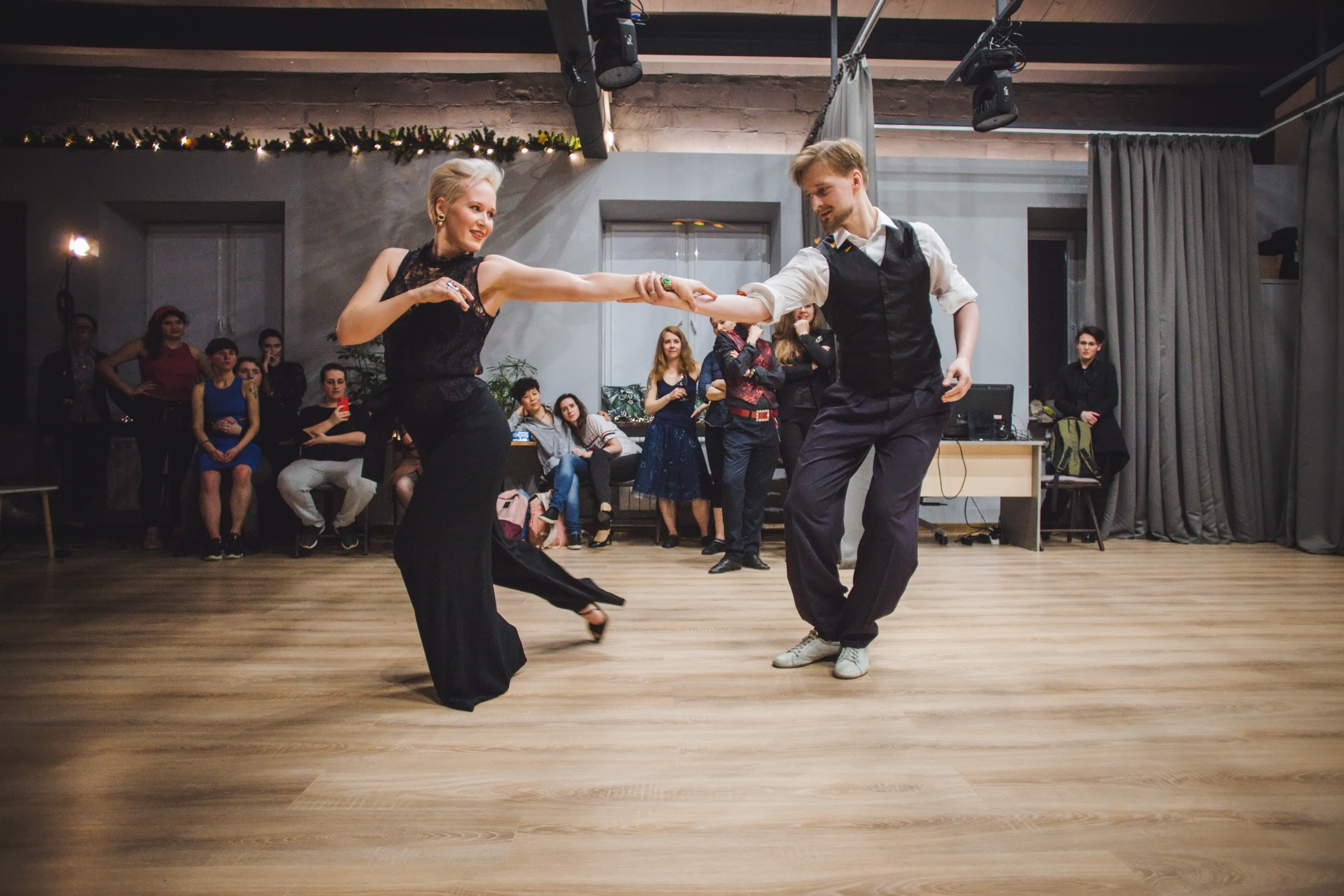 Two people dance at a studio together