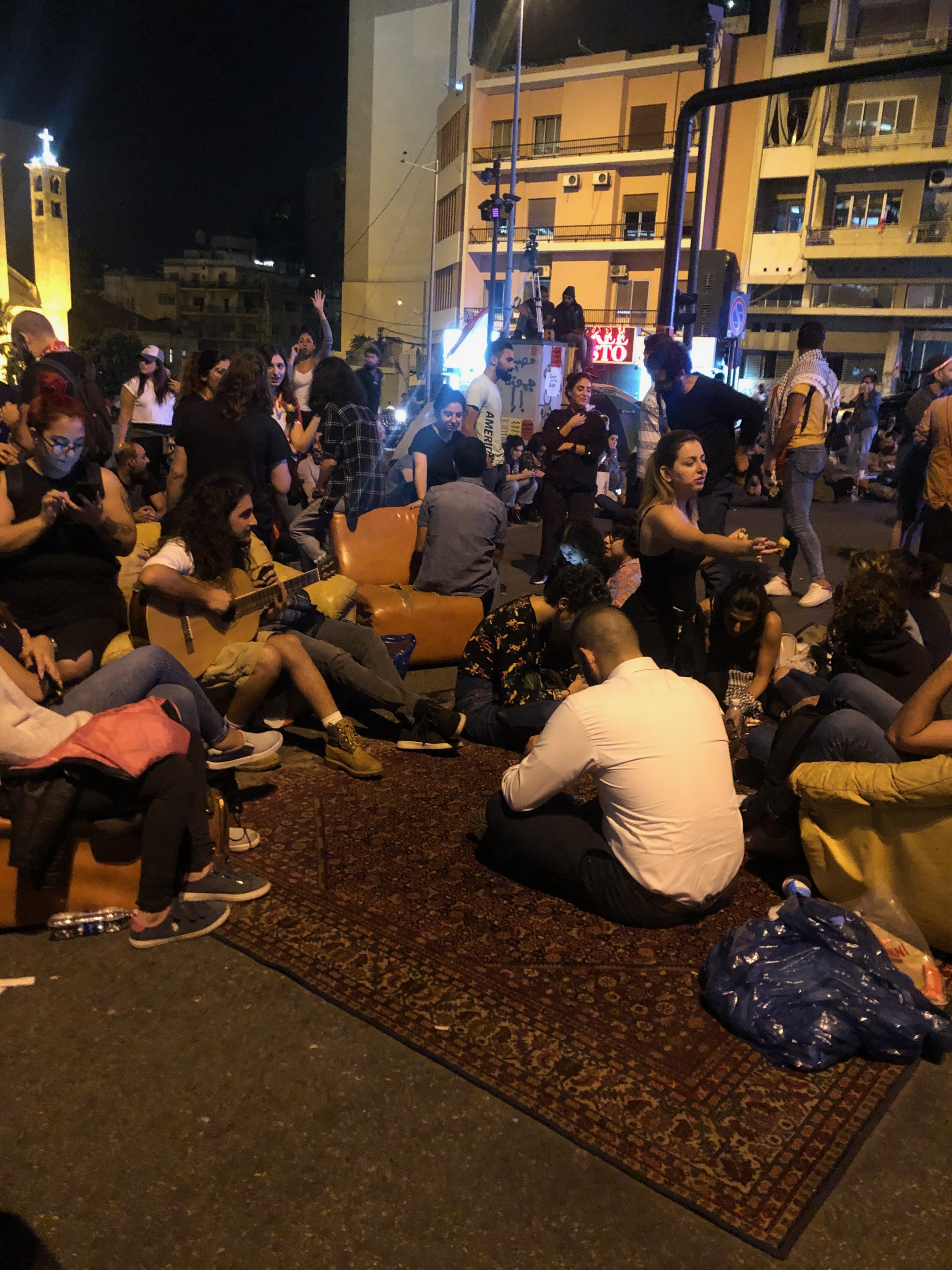 Protesters lay on a carpet as they block Beirut's Ring Bridge.