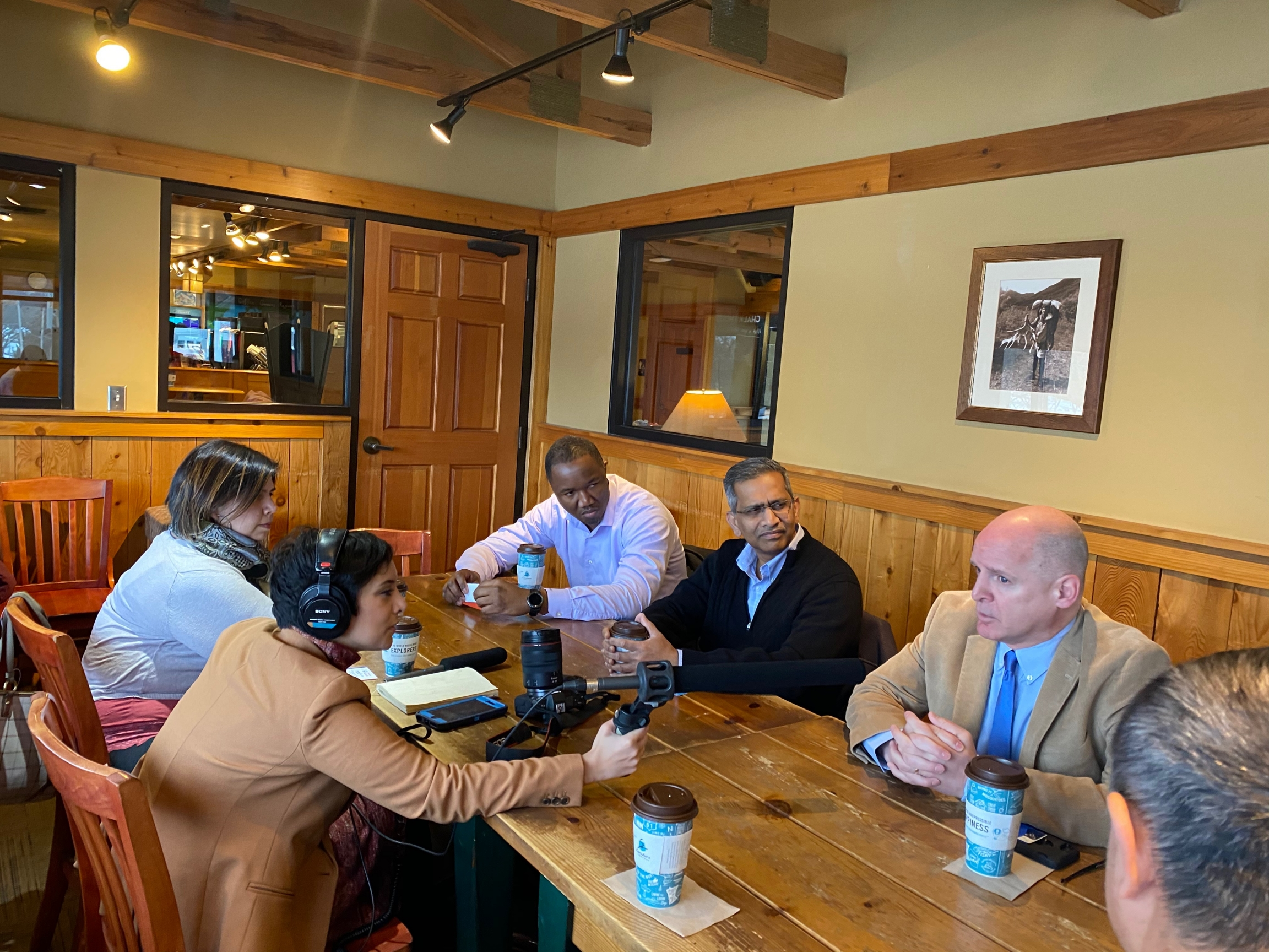 Reporter Rupa Shenoy meets with politically active immigrants and refugees in the back conference room of a Caribou Coffee in Des Moines.