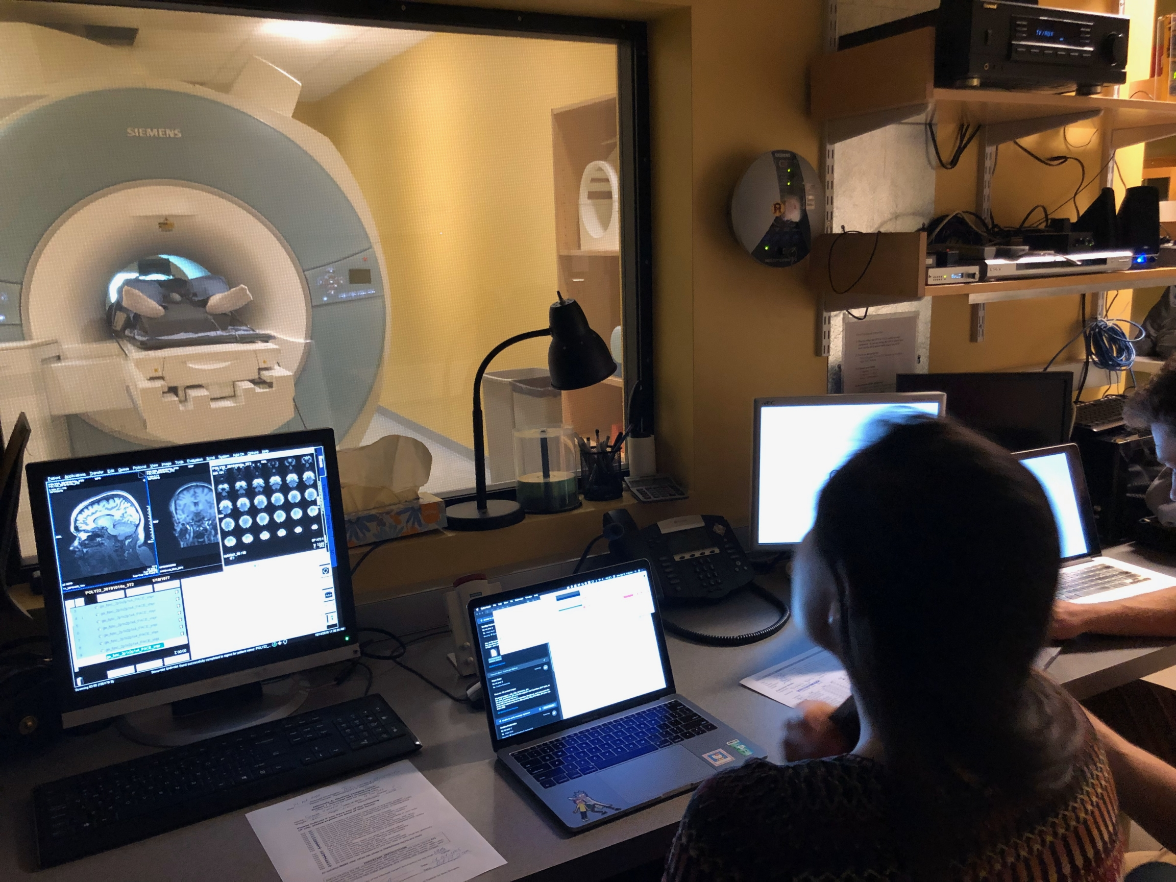 From the lab's control room, lab manager Hope Kean is shown at the controls with Susanna Zaraysky in the fMRI.