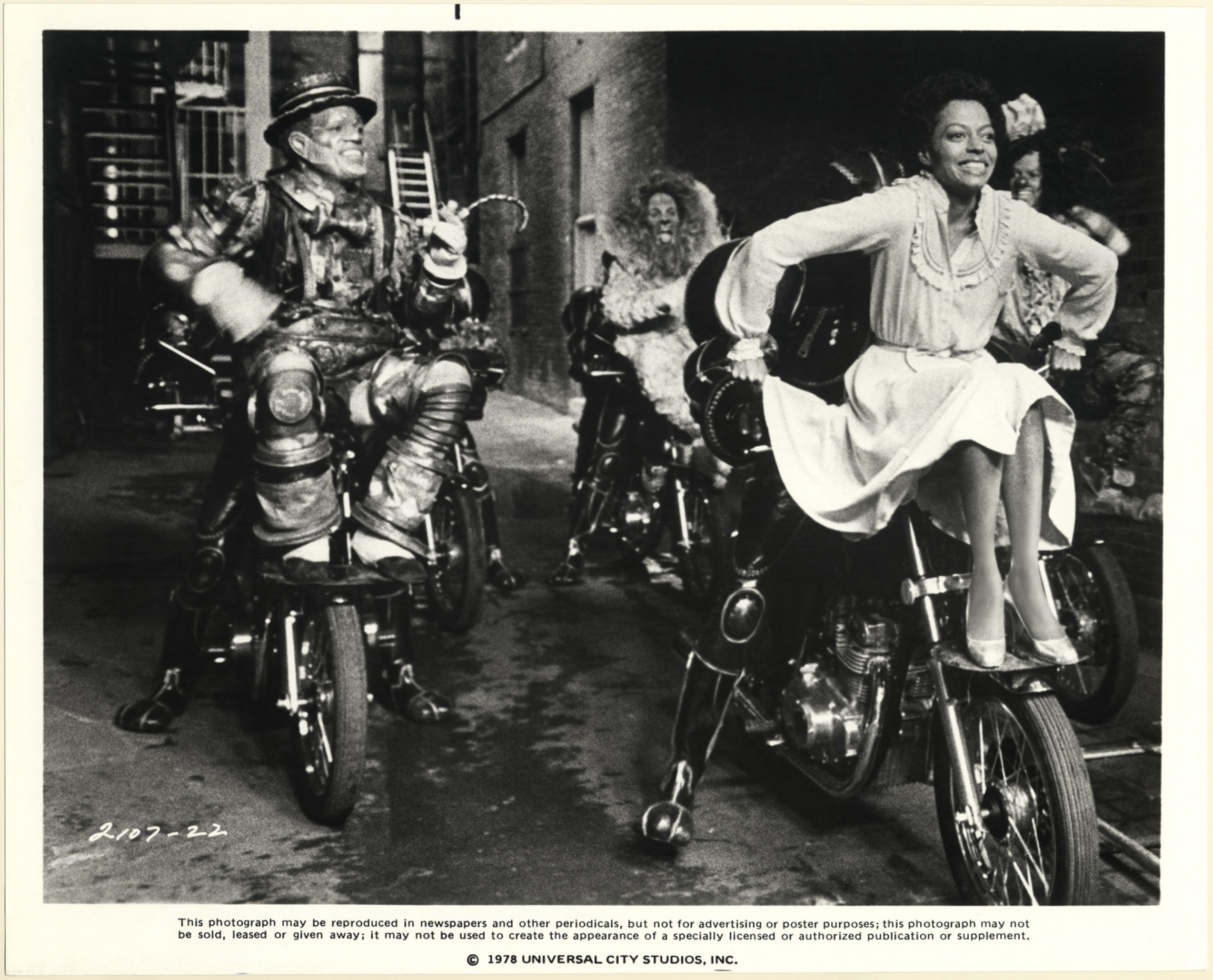 """Diana Ross, as Dorothy, Nipsey Russell, as the Tinman (left foreground), Ted Ross, as the Lion (center background) and Michael Jackson, as the Scarecrow (right background) in """"The Wiz,"""" filmed at Kaufman Astoria Studios."""