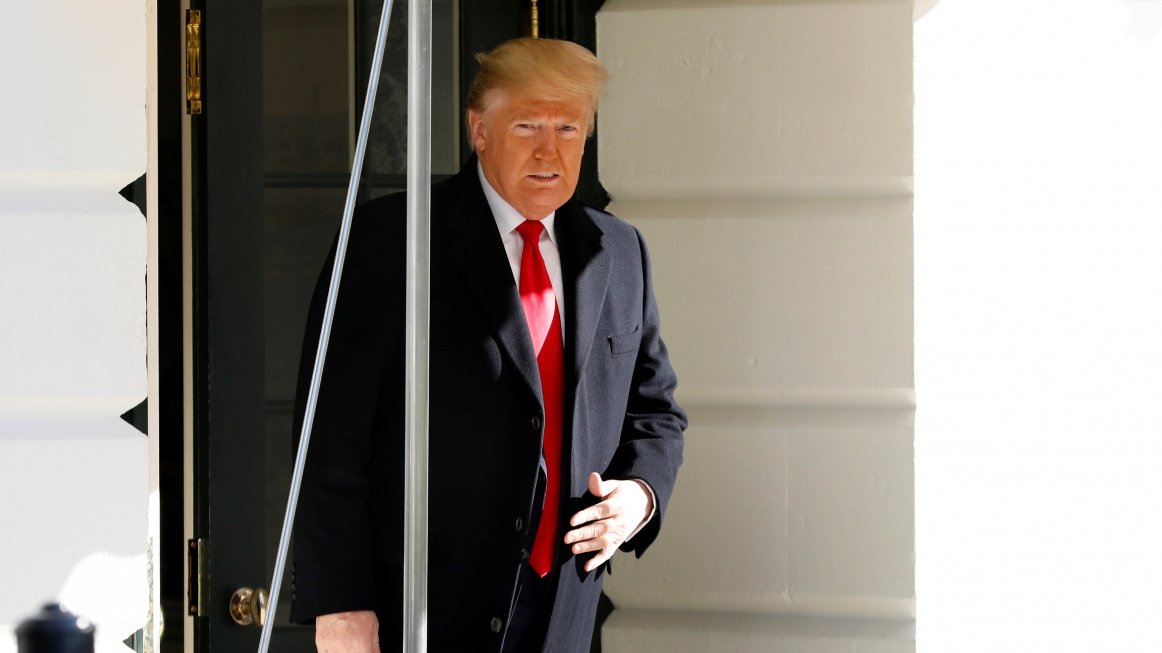 US President Donald Trump walks out from the the White House in Washington before his departure to India, Feb. 23, 2020.