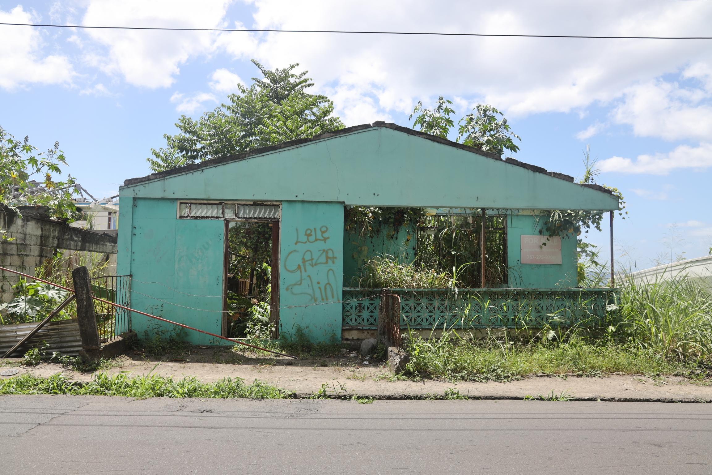 A home, damaged and abandoned, on the southwest coast of Dominica.