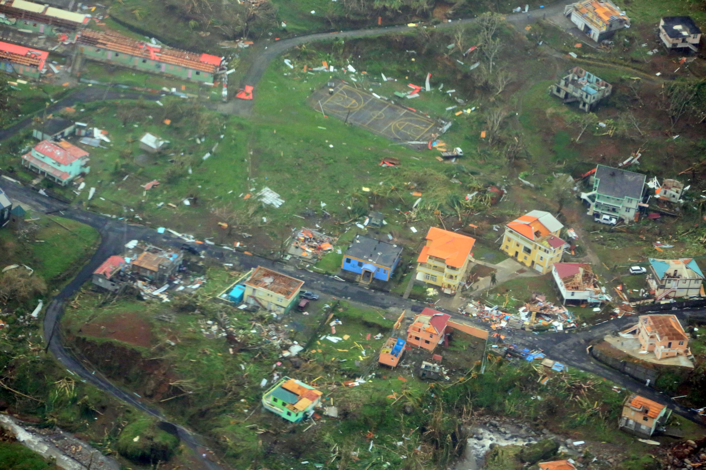 Damaged homes from Hurricane Maria are shown in this aerial photo over the island of Dominica, Sept. 19, 2017.