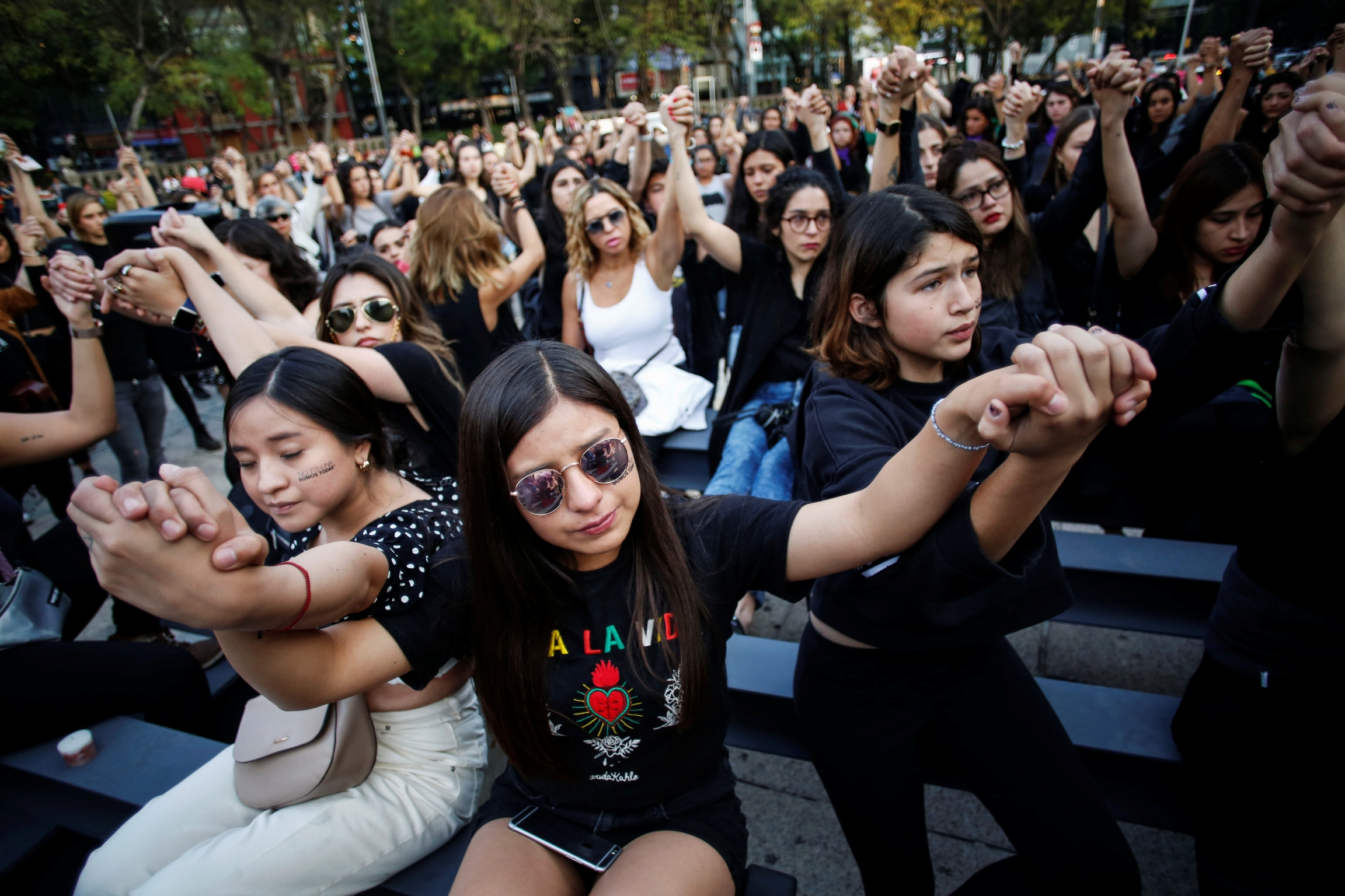 Women protest against gender violence and femicides at Angel de la Independencia monument in Mexico City, Mexico, Feb. 22, 2020.