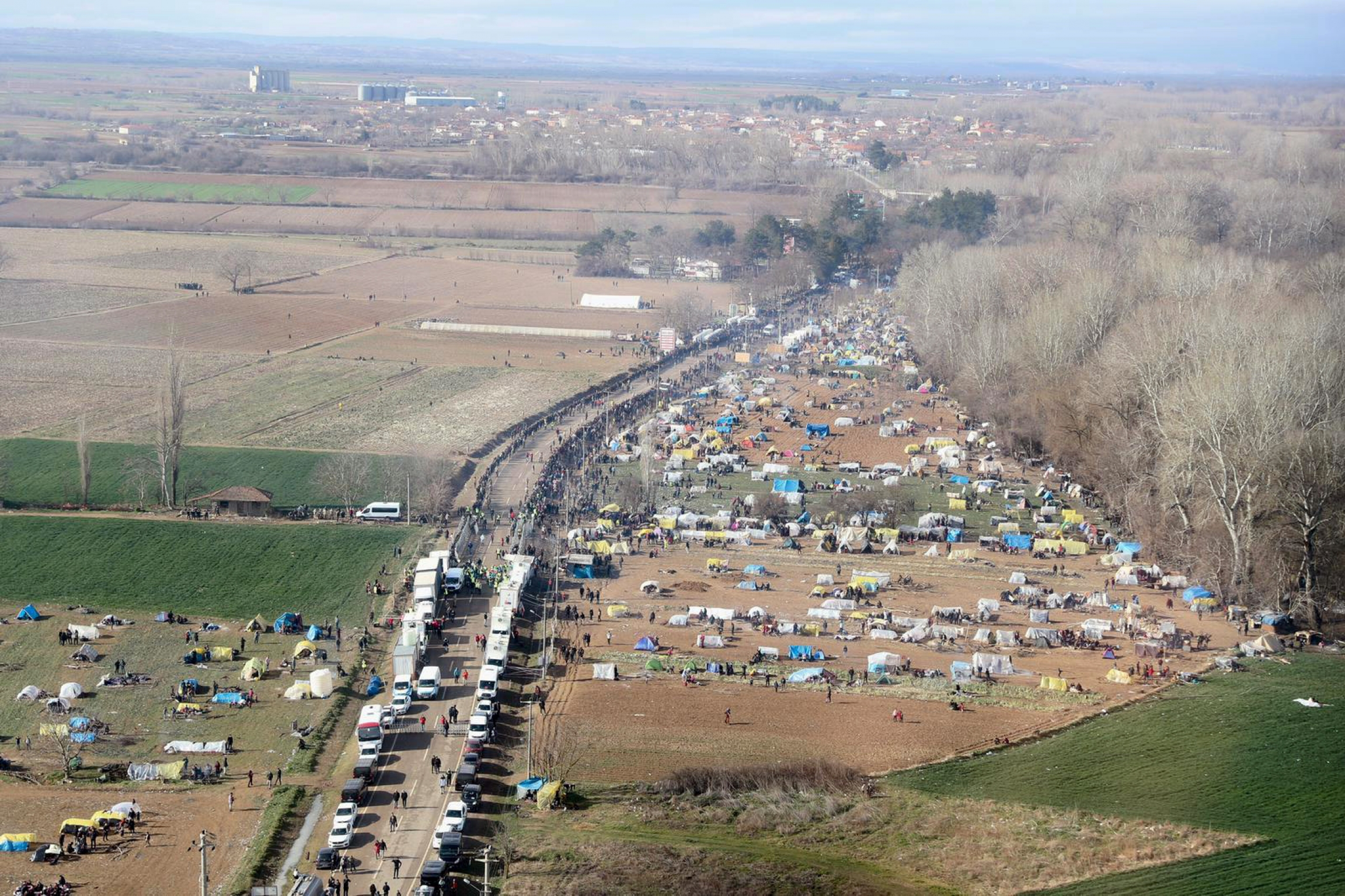 An aerial photo taken from the helicopter of Turkish Interior Minister Suleyman Soylu shows migrants waiting in line to receive food at Turkey's Pazarkule border crossing with Greece's Kastanies, near Edirne in Turkey, on March 5, 2020.