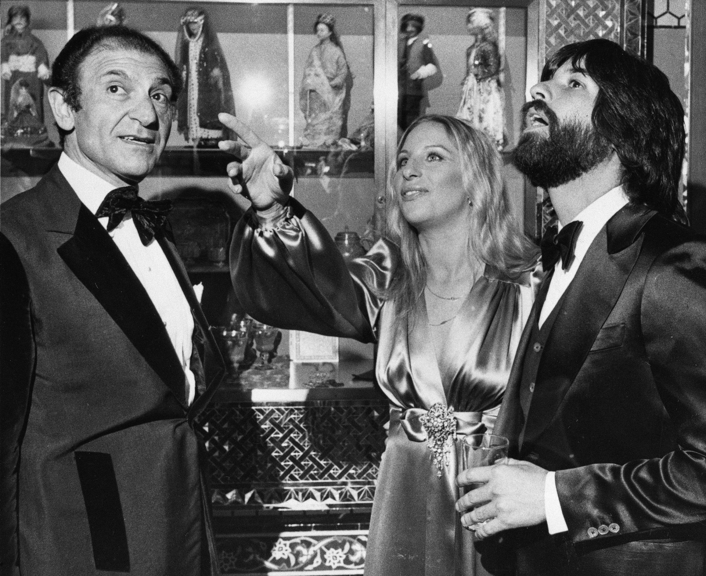 Iran's former Ambassador Ardeshir Zahedi, left, talks with actress Barbra Streisand is shown looking up and pointing.