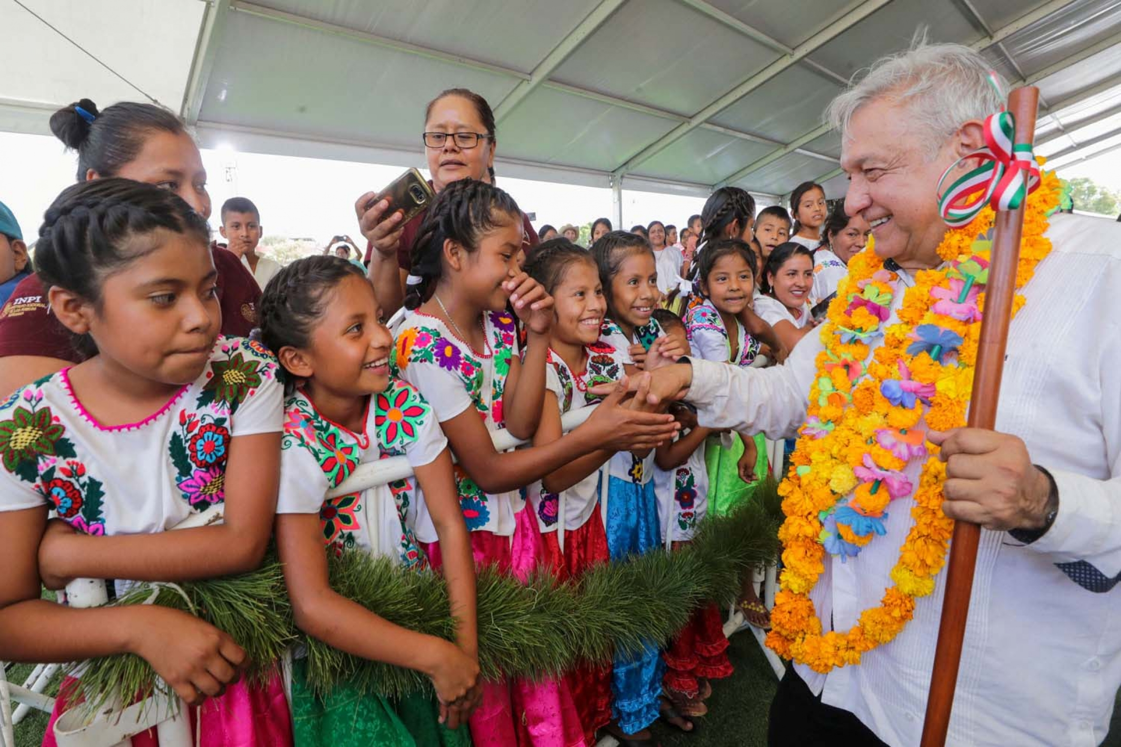 "Mexico's President Andres Manuel Lopez Obrador shakes hands with girls while visiting towns in the southwestern state of Guerrero, as Mexico's health ministry urged people to mantain a ""healthy distance"" to avoid infection and spread of coronavirus."