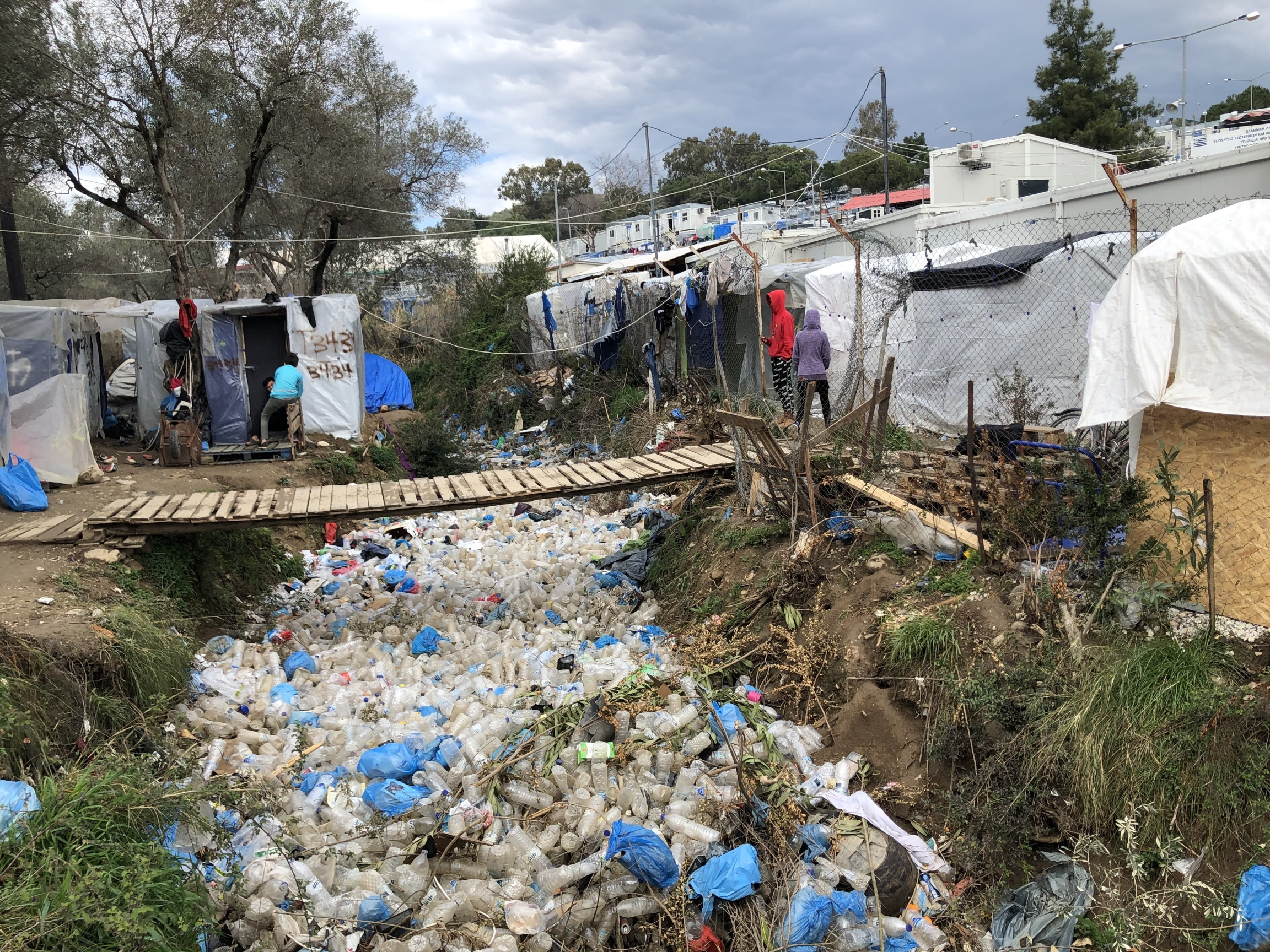 Garbage is strewn between tents in Moria, an overcrowded refugee camp on the Greek island of Lesbos.