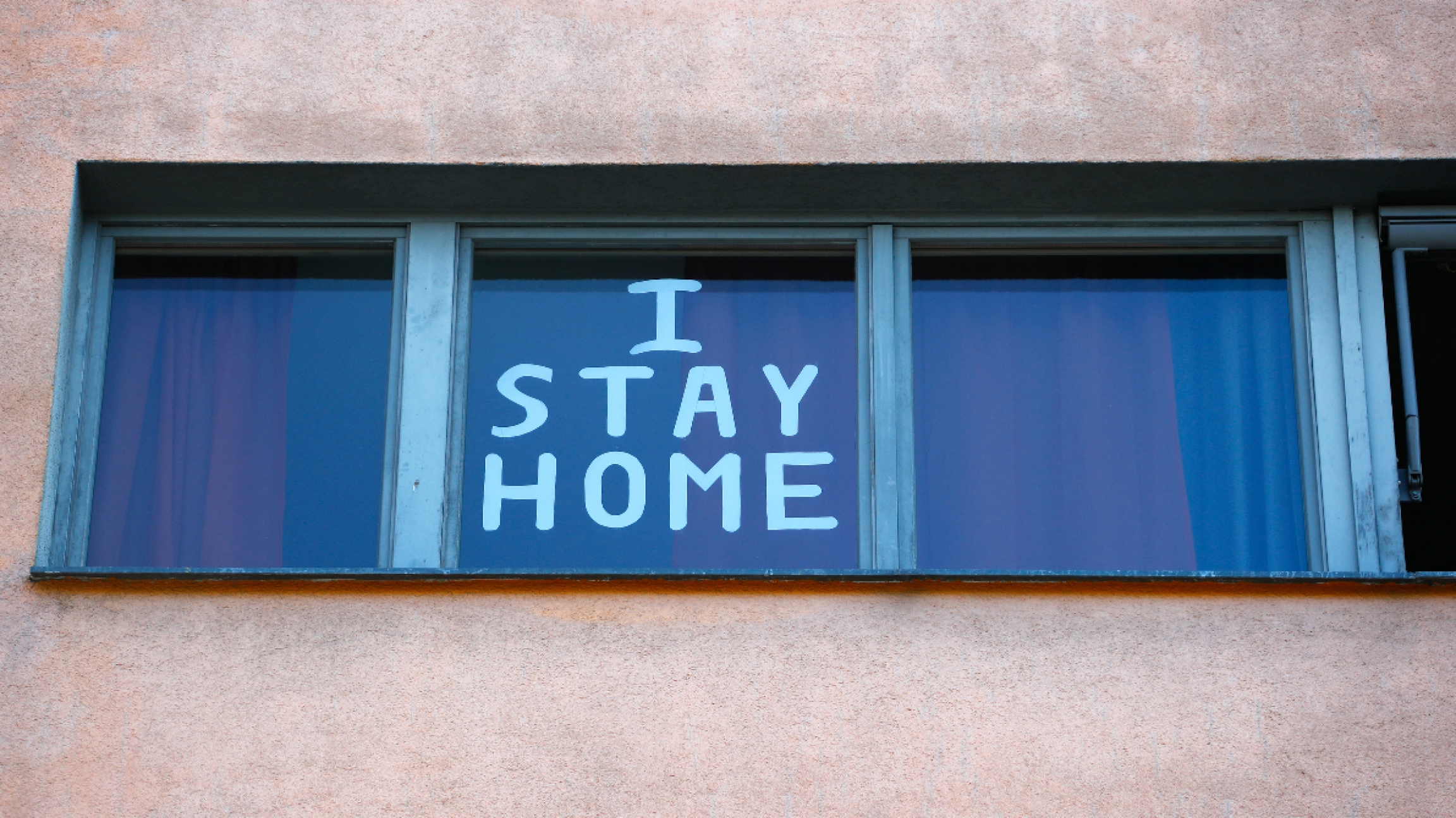 a sign on the window reads, I stay home.