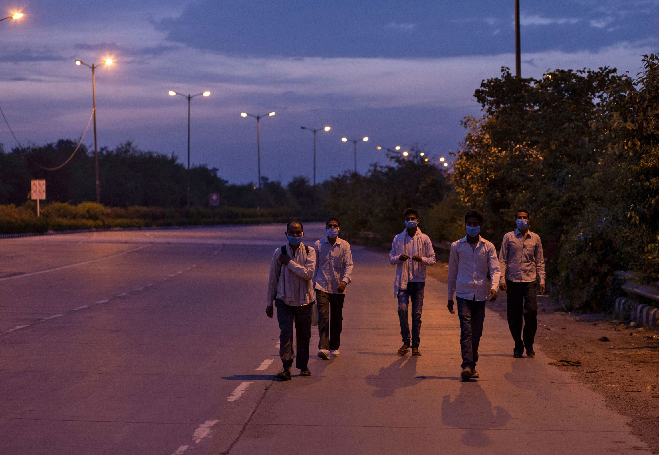 Men walk in twilight