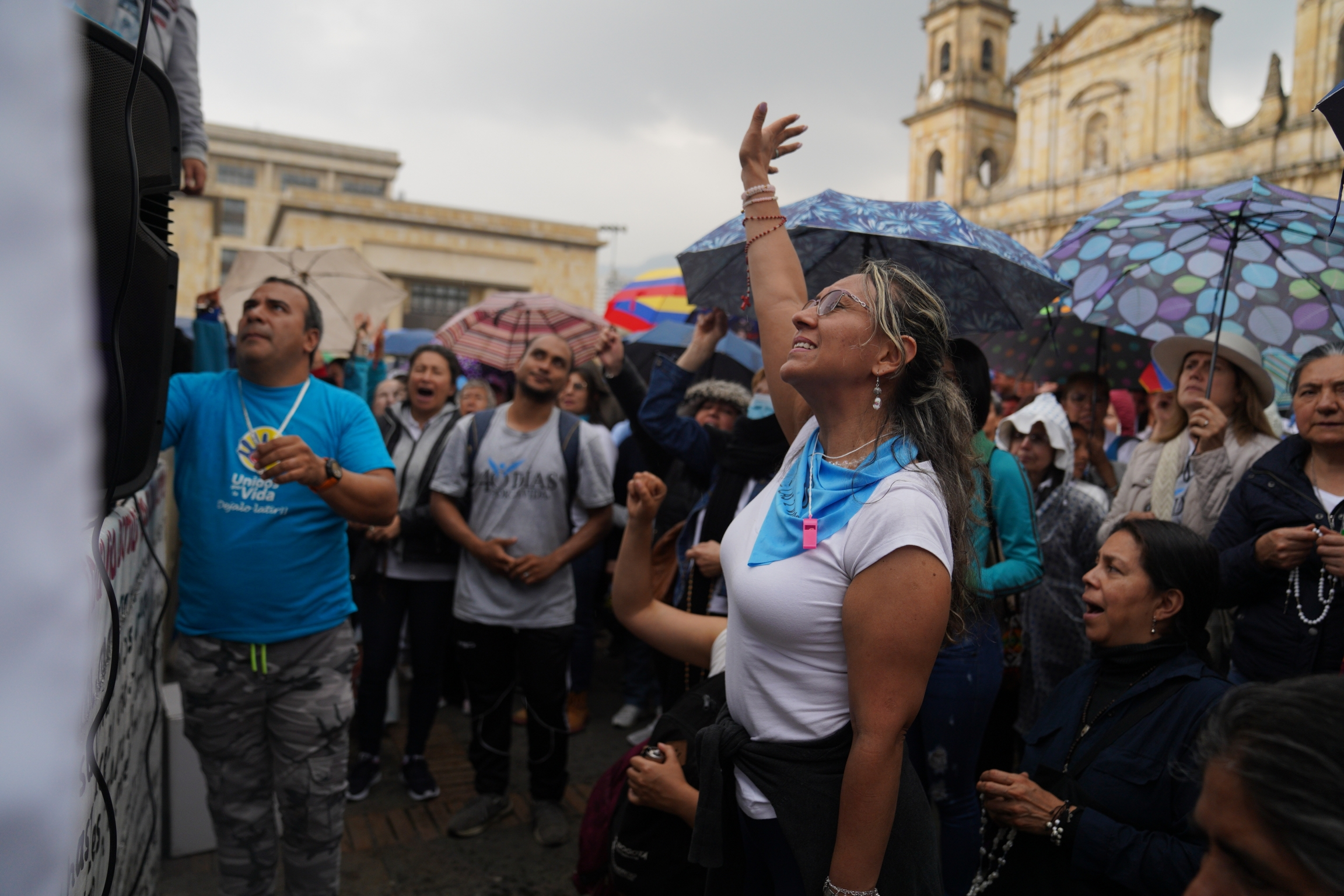A demonstrator prays during a protest against efforts to liberalize abortion outside a cathedral in Bogotá, Colombia, Feb. 22, 2020.