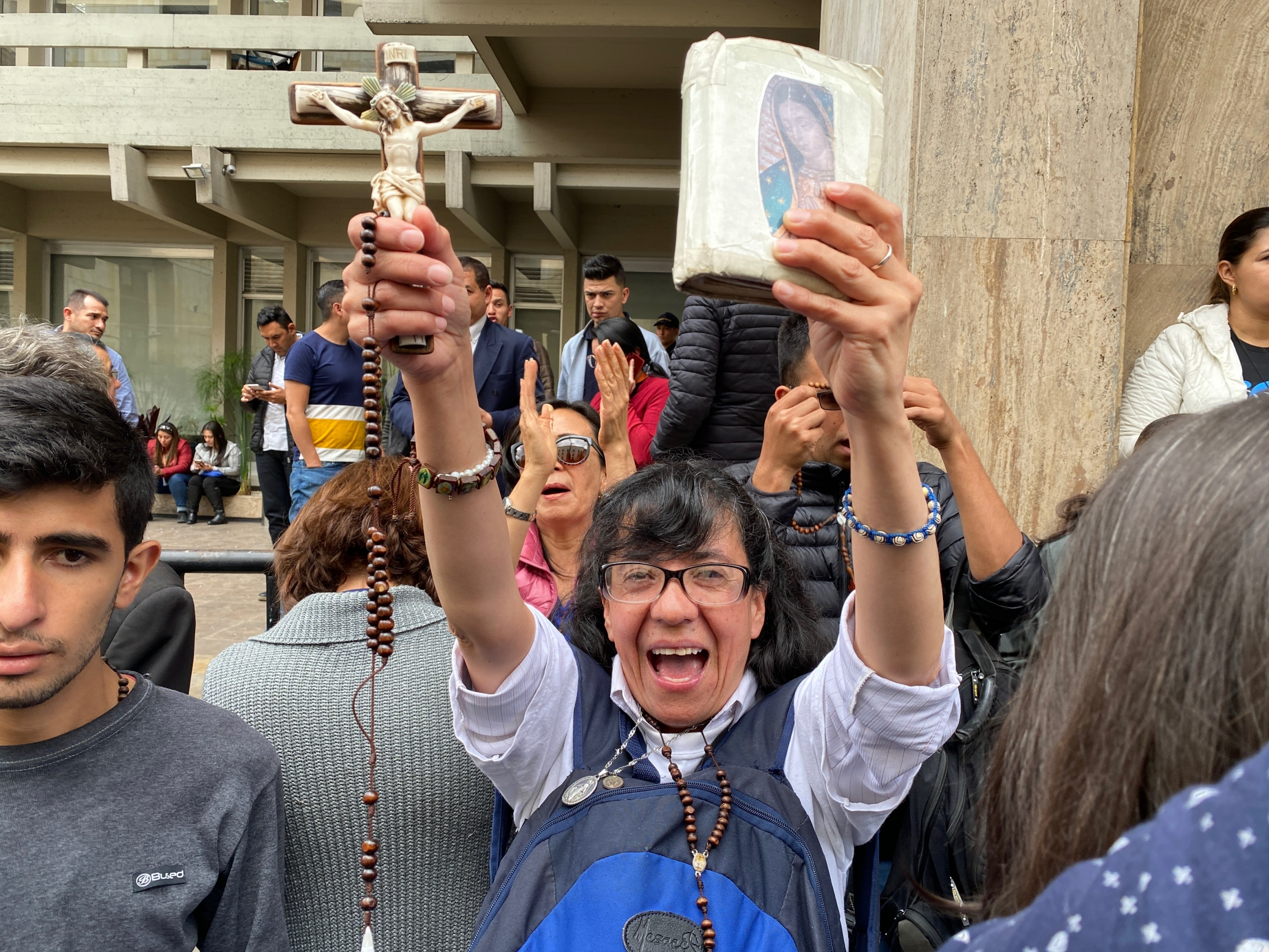 A demonstrator displays her bible and crucifix during a protest outside Colombia's constitutional court.