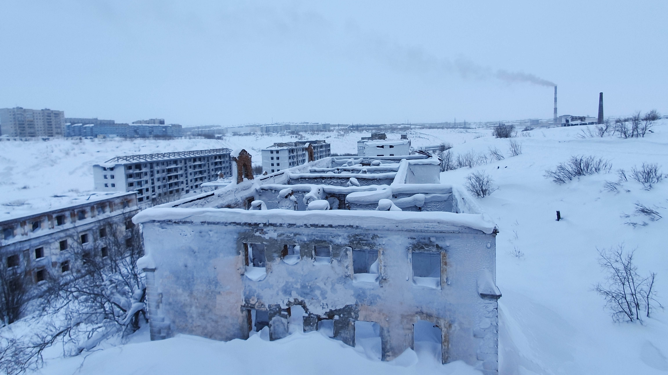 Abandoned snow-covered buildings