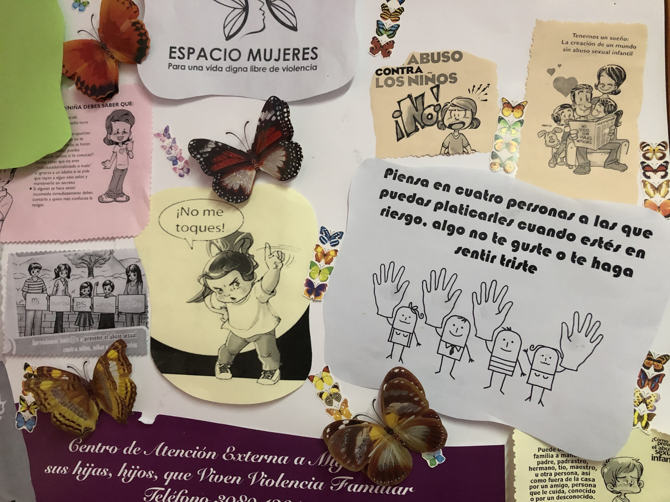Signs at a women's shelter in Mexico City encourage female empowerment and tips for women facing violence.