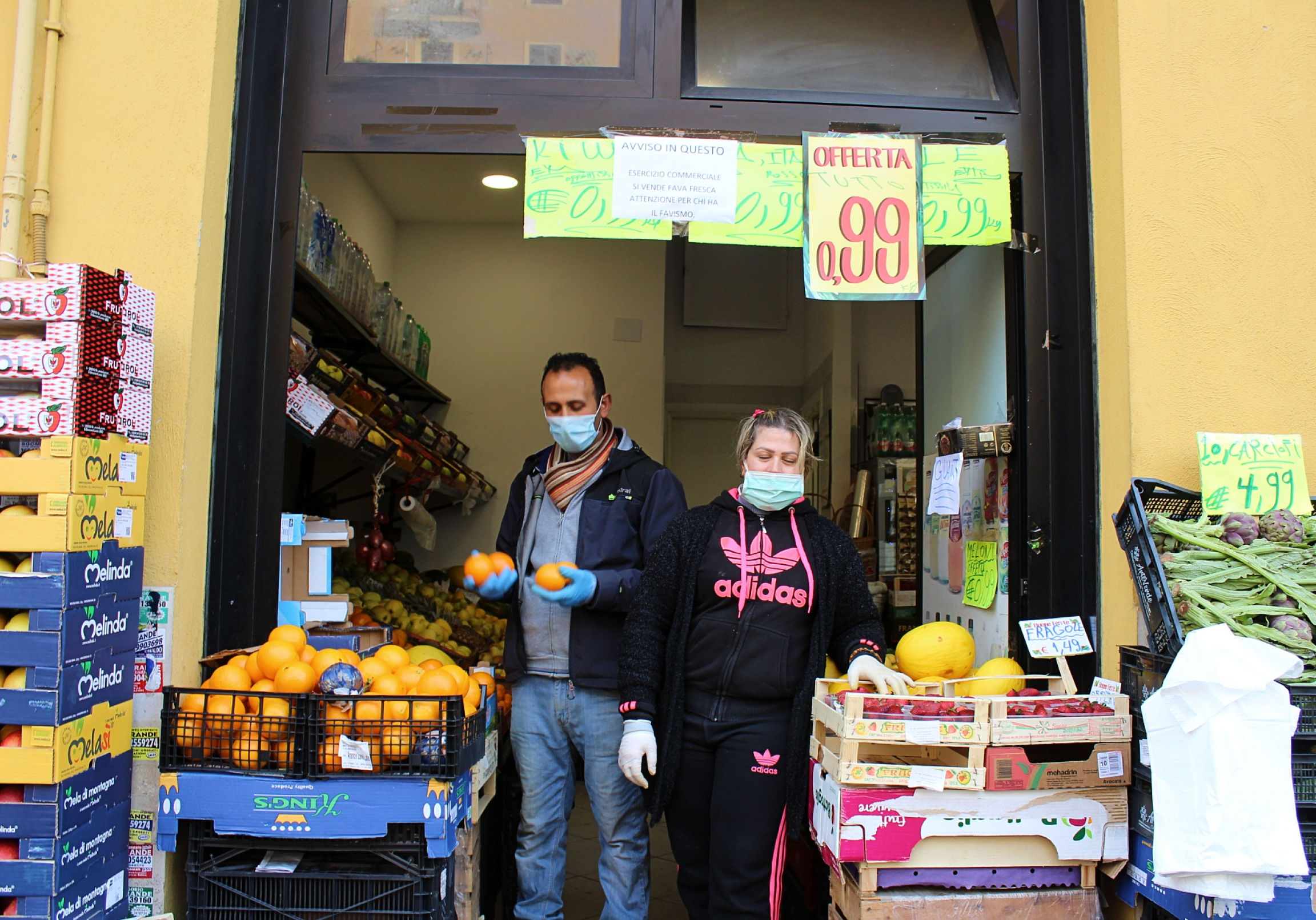 Groceries, like thisfruit shop in Torpignattara, Italy, are allowed to stay open