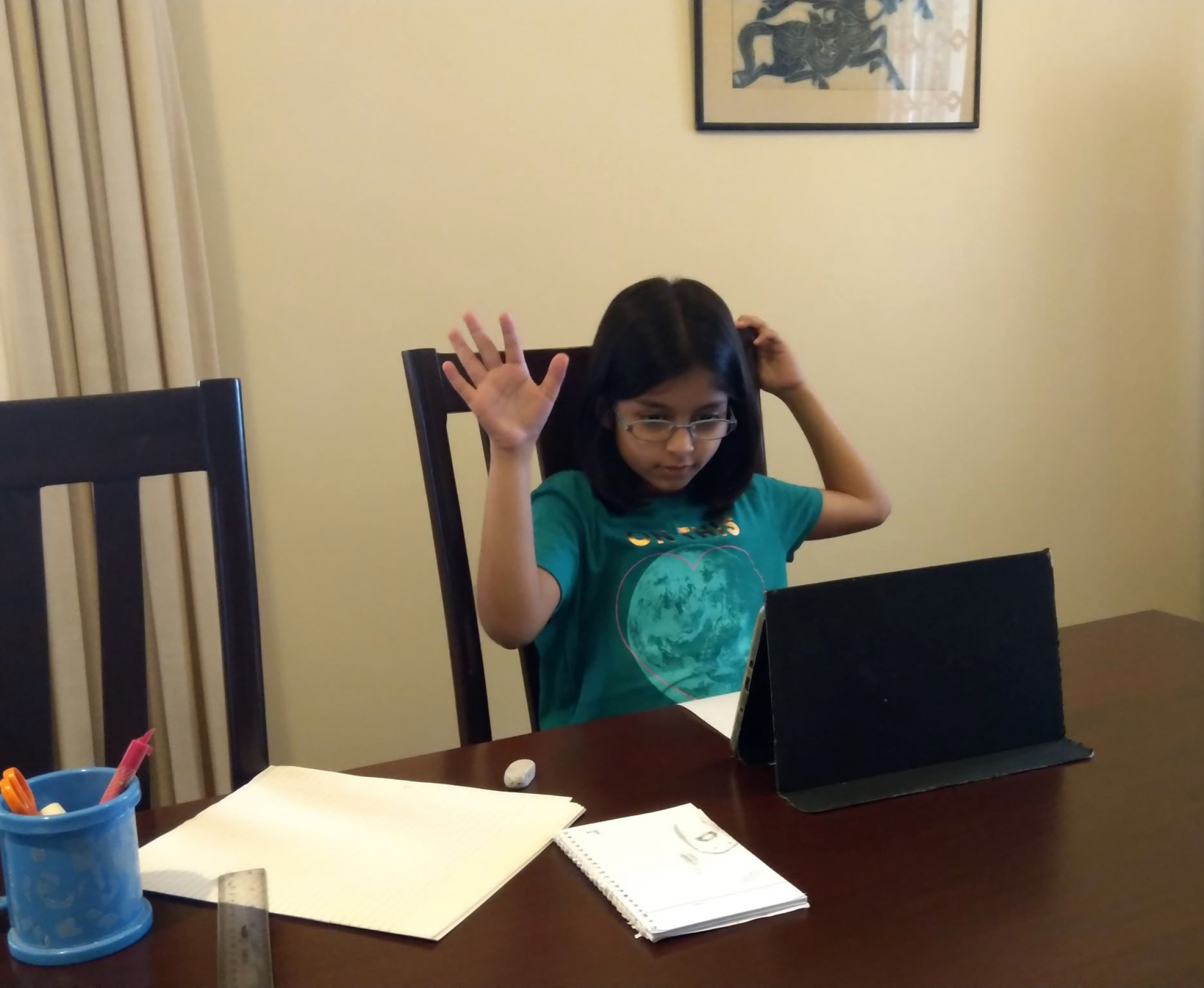 Farah Husain of Karachi, Pakistan, participates in her online school lesson from home.