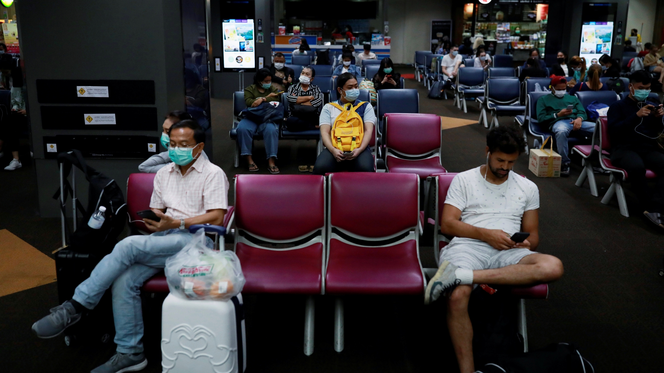 Passengers wear protective masks due to the coronavirus outbreak, at Don Mueang airport in Bangkok, Thailand, March 9, 2020.