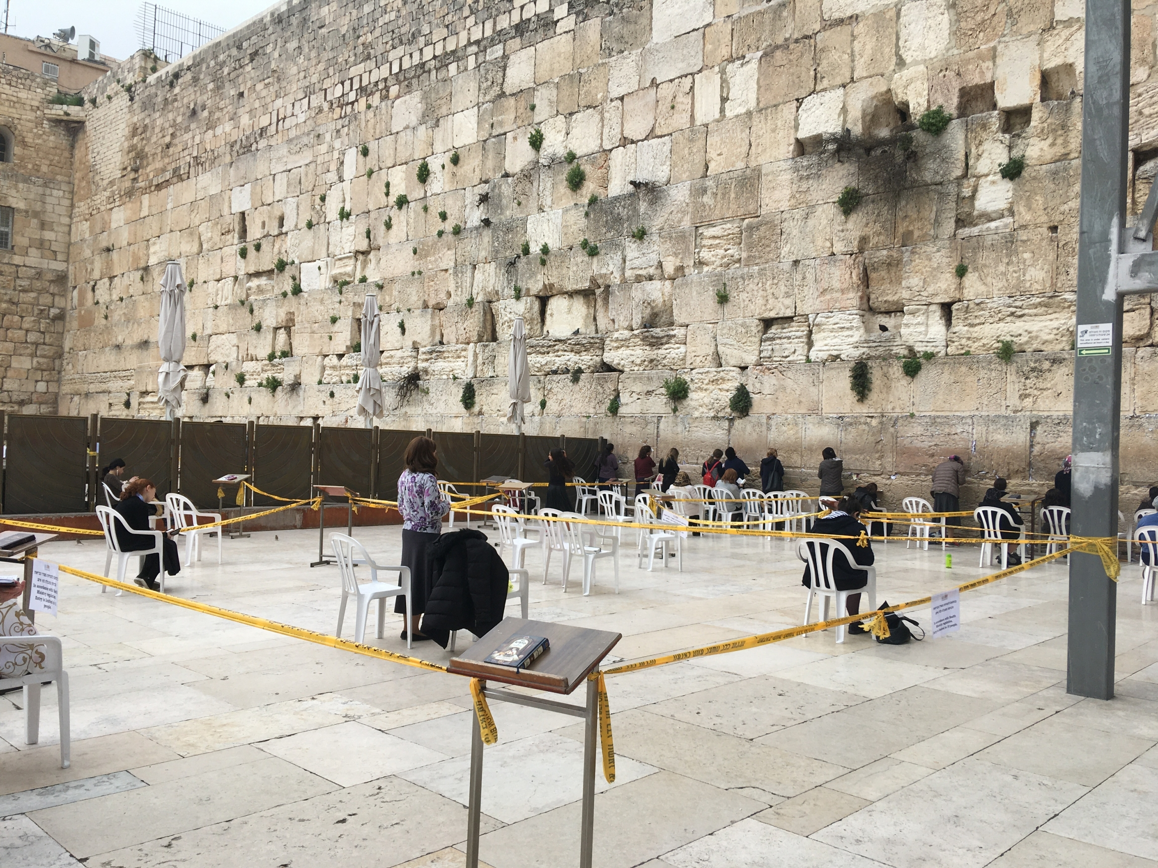At the Western Wall, prayer is cordoned into sections. Only 10 people at a time may worship in each subsection.