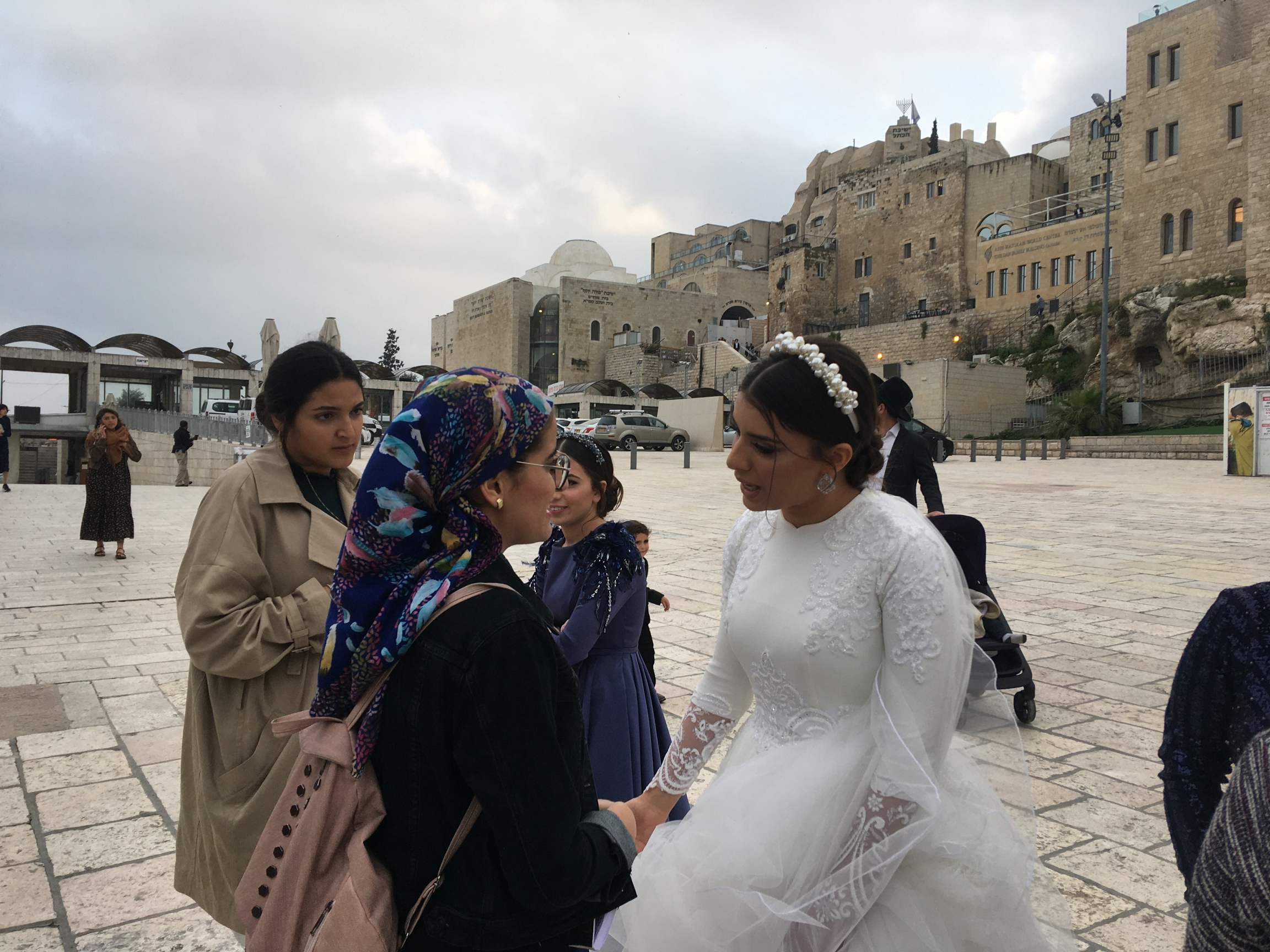 Idit Tedgi gets close to other worshippers to offer blessings on her wedding day.