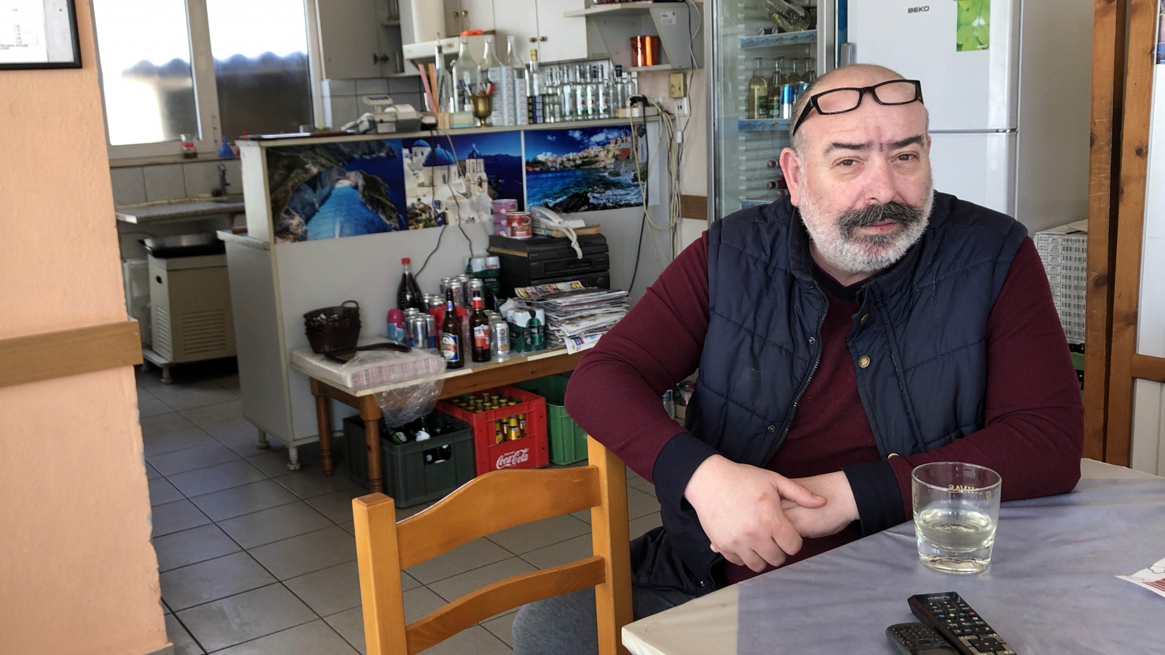 Stelios Panagos sits at his cafe inKastanies. On a typical day, the cafe is filled with local Greeksas well as Turks.