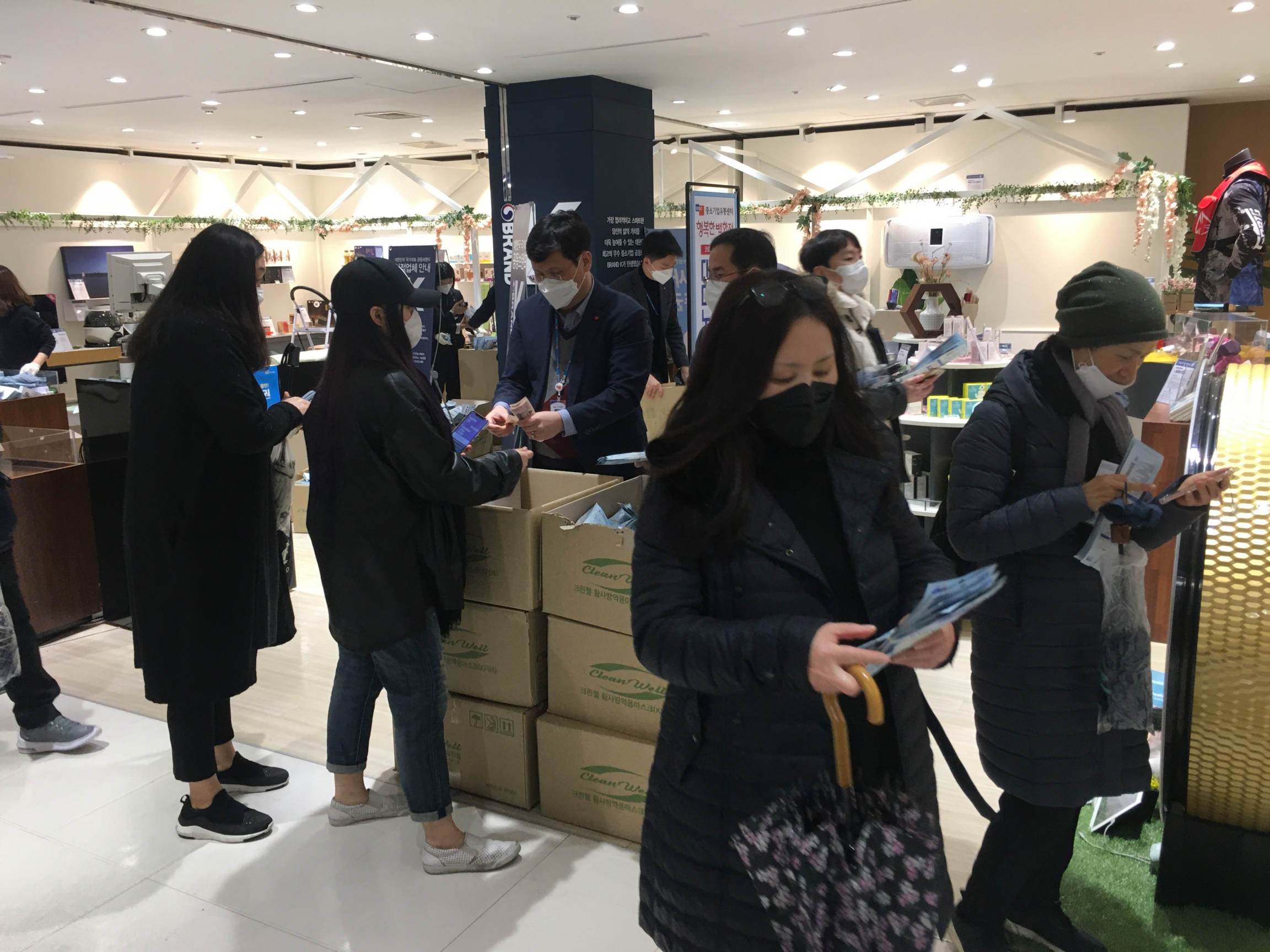 Shoppers buy subsidized respiratory masks at a department store in Seoul, South Korea.