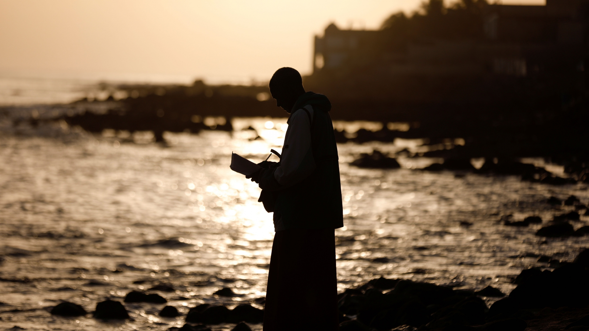 A man meditates at the beach amid the outbreak of the coronavirus disease (COVID-19), in Dakar, Senegal, March 26, 2020.