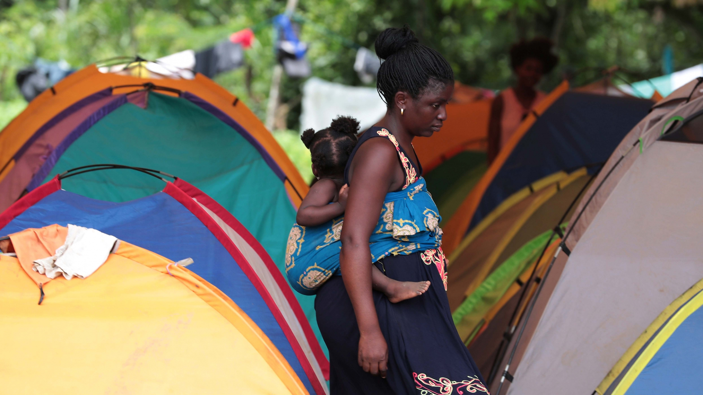 Migrants are seen at temporary shelter in the village of La Penita, Panama, on August 23, 2019.