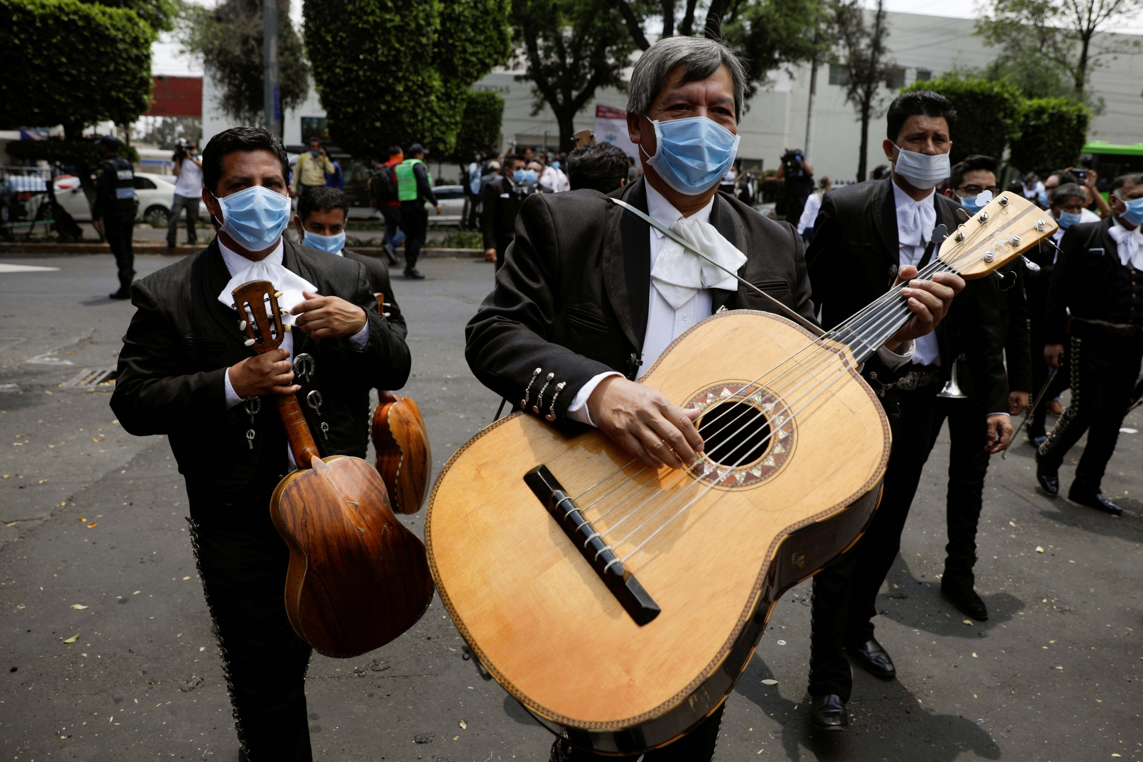 Members of a mariachi band wearing masks are seen after delivering a serenade for the medical staff of the National Institute of Respiratory Diseases during the coronavirus outbreak, in Mexico City, Mexico, April 7, 2020.