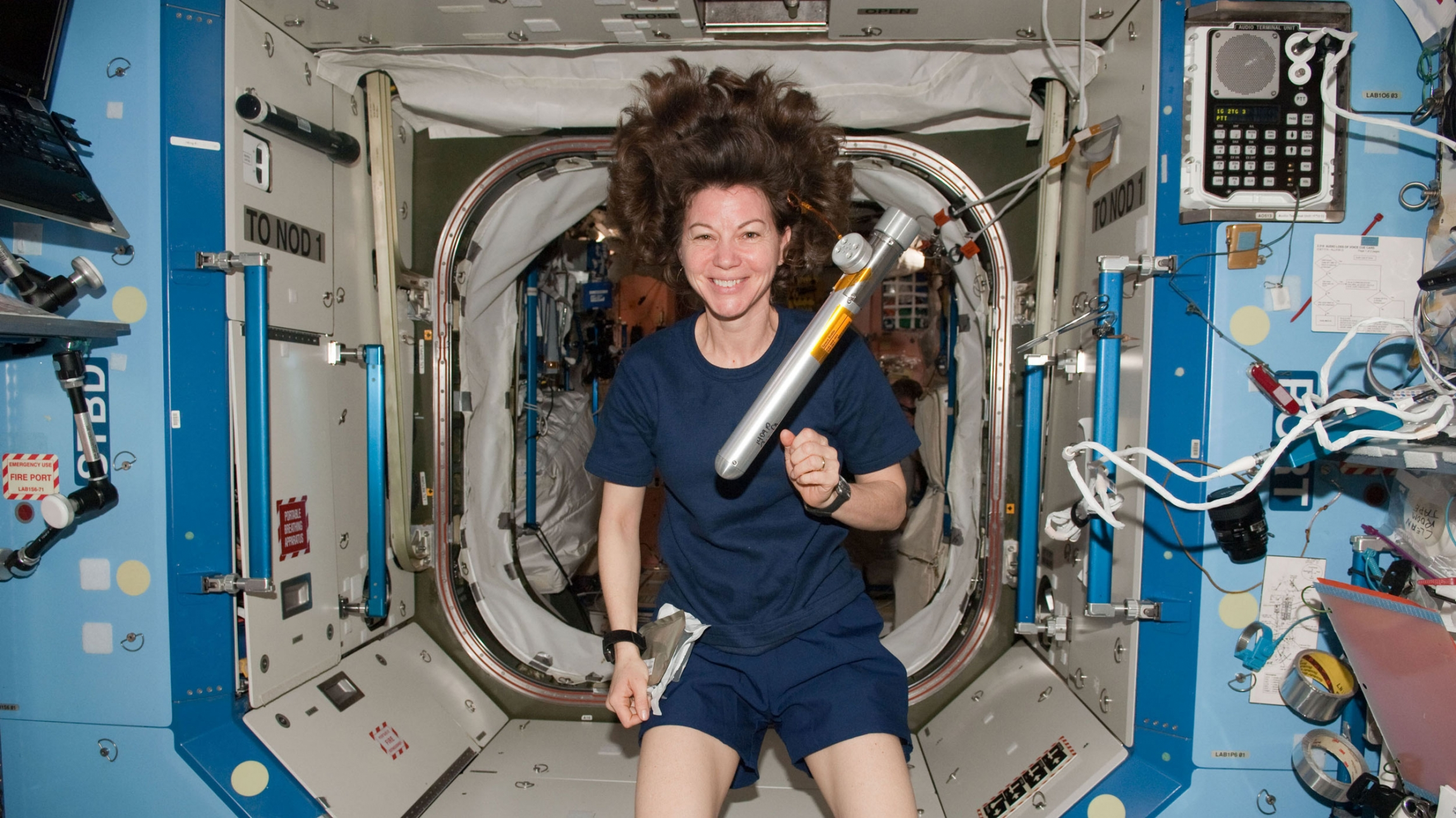 A woman floats in a spacecraft