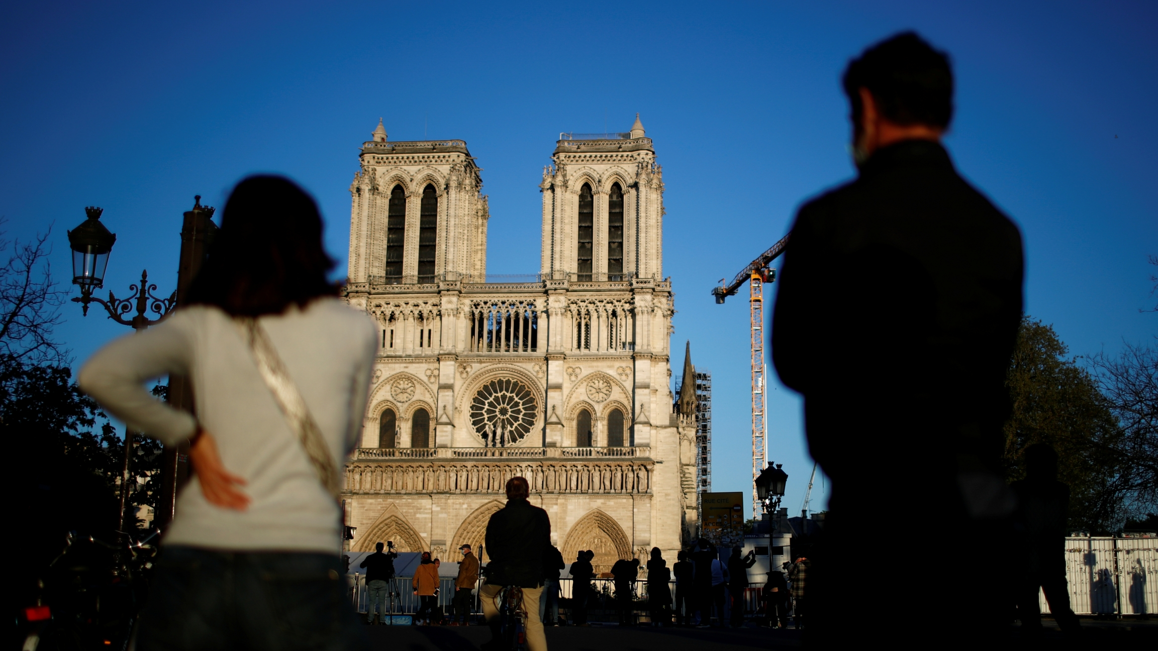 Two people look at Notre Dame