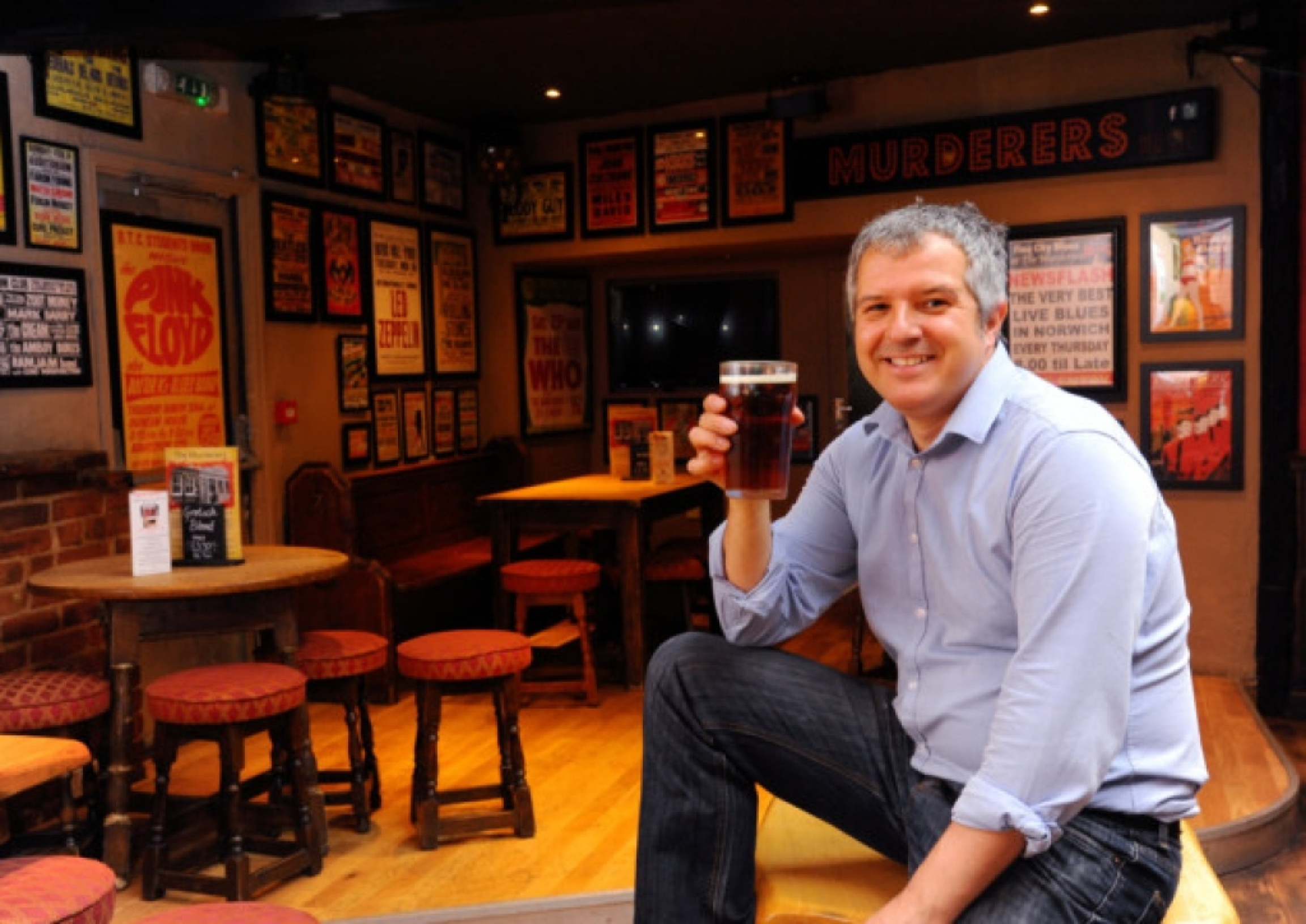 A man enjoys a beer in a pub