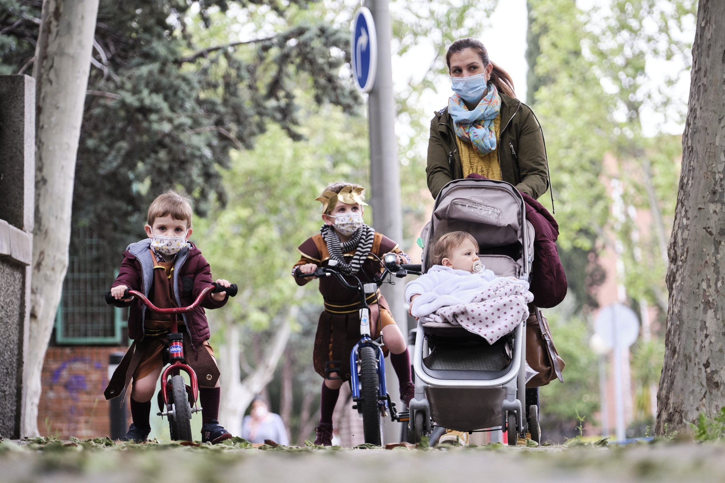 Begoña, a mother of three, takes her children for a walk on the day Spain lifts restrictions on children outdoors due to the coronavirus pandemic