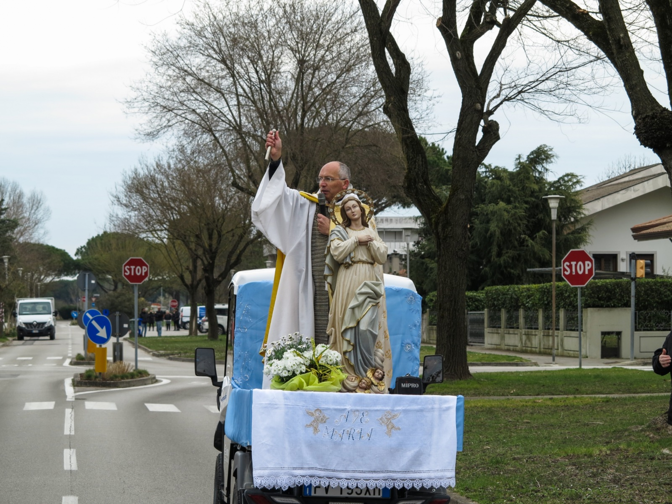 Rev. Andrea Vena, the priest of Bibiano, a small town on the coast near Venice, loaded a statue of the madonna on a three-wheeled car and set off along the streets of his town one March morning.