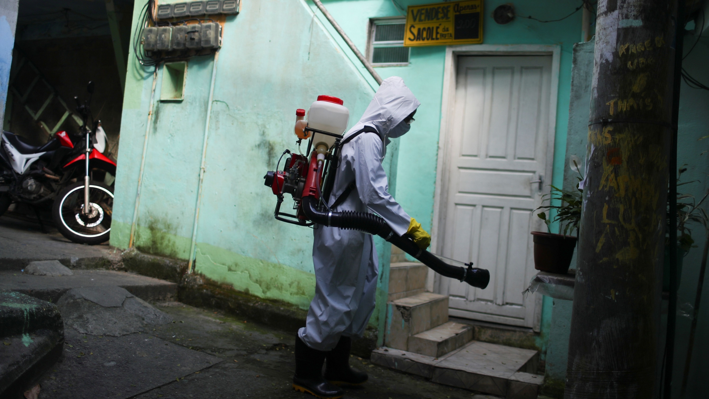 A worker disinfects the streets of the Vidigal slum, following the coronavirus disease (COVID-19) outbreak, in Rio de Janeiro, Brazil, April 24, 2020.
