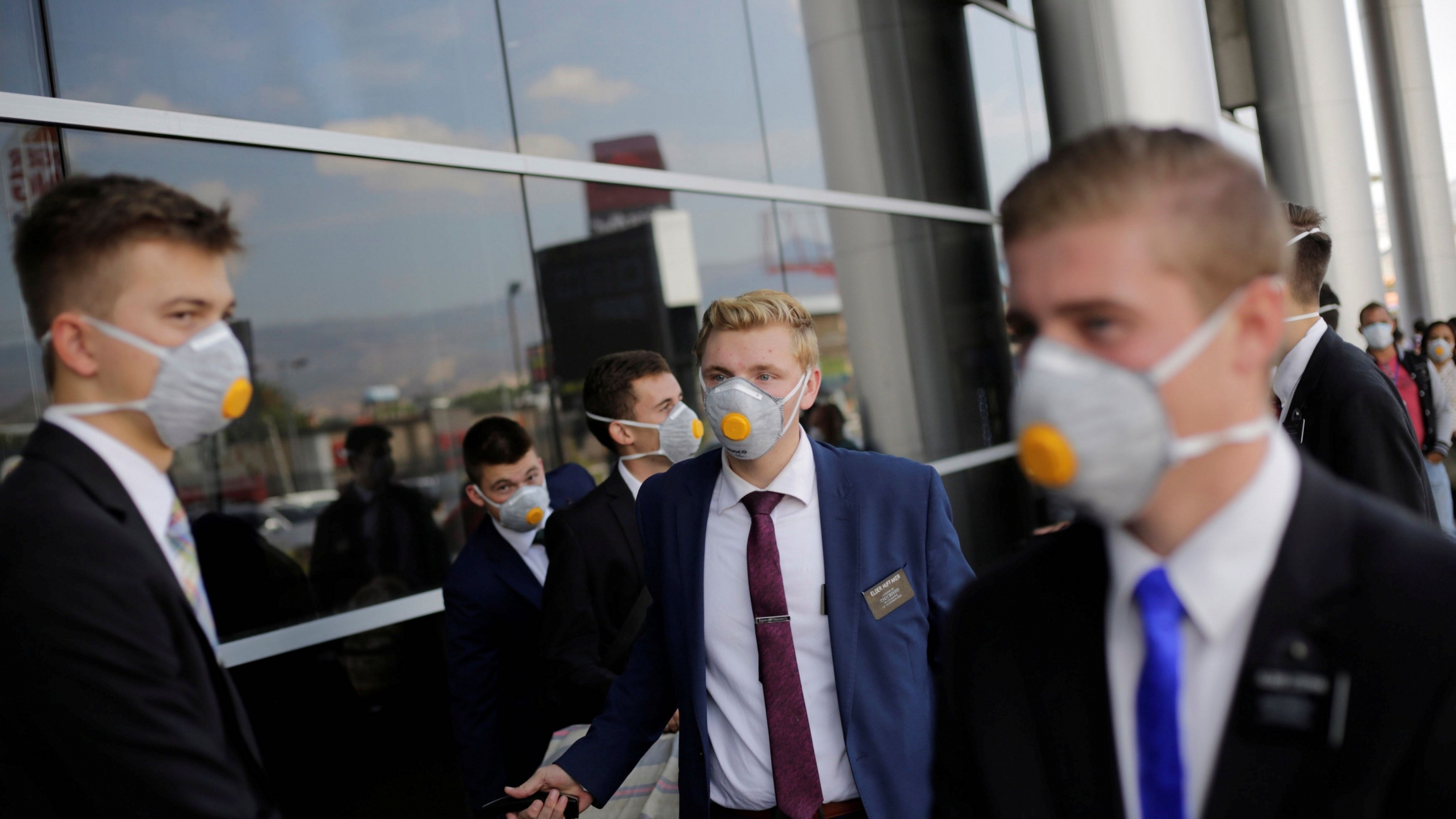 US members of The Church of Jesus Christ of Latter-day Saints, wearing protective masks, gather at Toncontin International airport before heading home, as the coronavirus disease (COVID-19) outbreak continues, in Tegucigalpa, Honduras, March 29, 2020.
