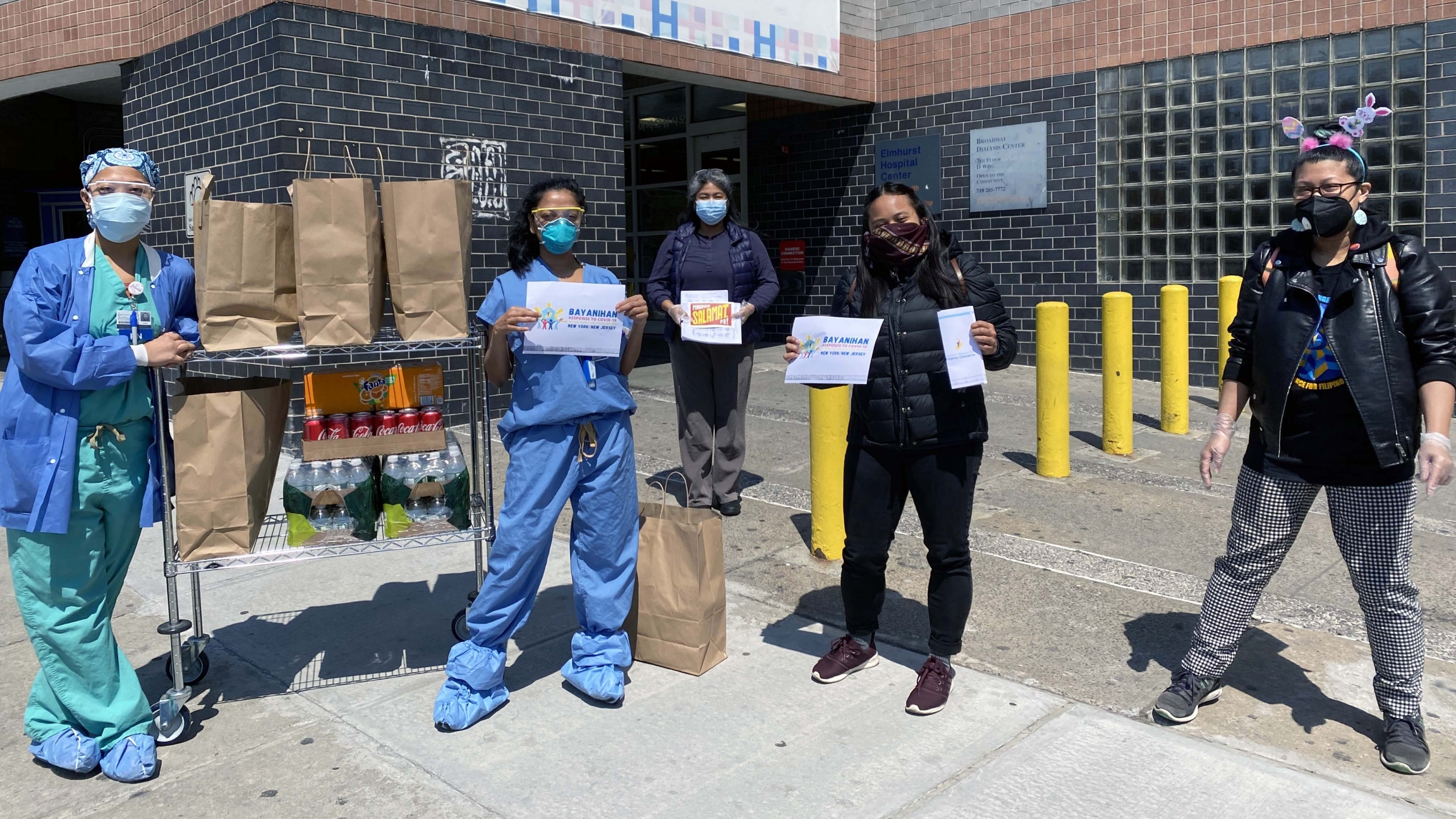 Filipino nurses on the front lines of the coronavirus pandemic at Elmhurst Hospital in Queens, New York City, pose with donated food from Meals to Heal, a Filipino American community initiative.