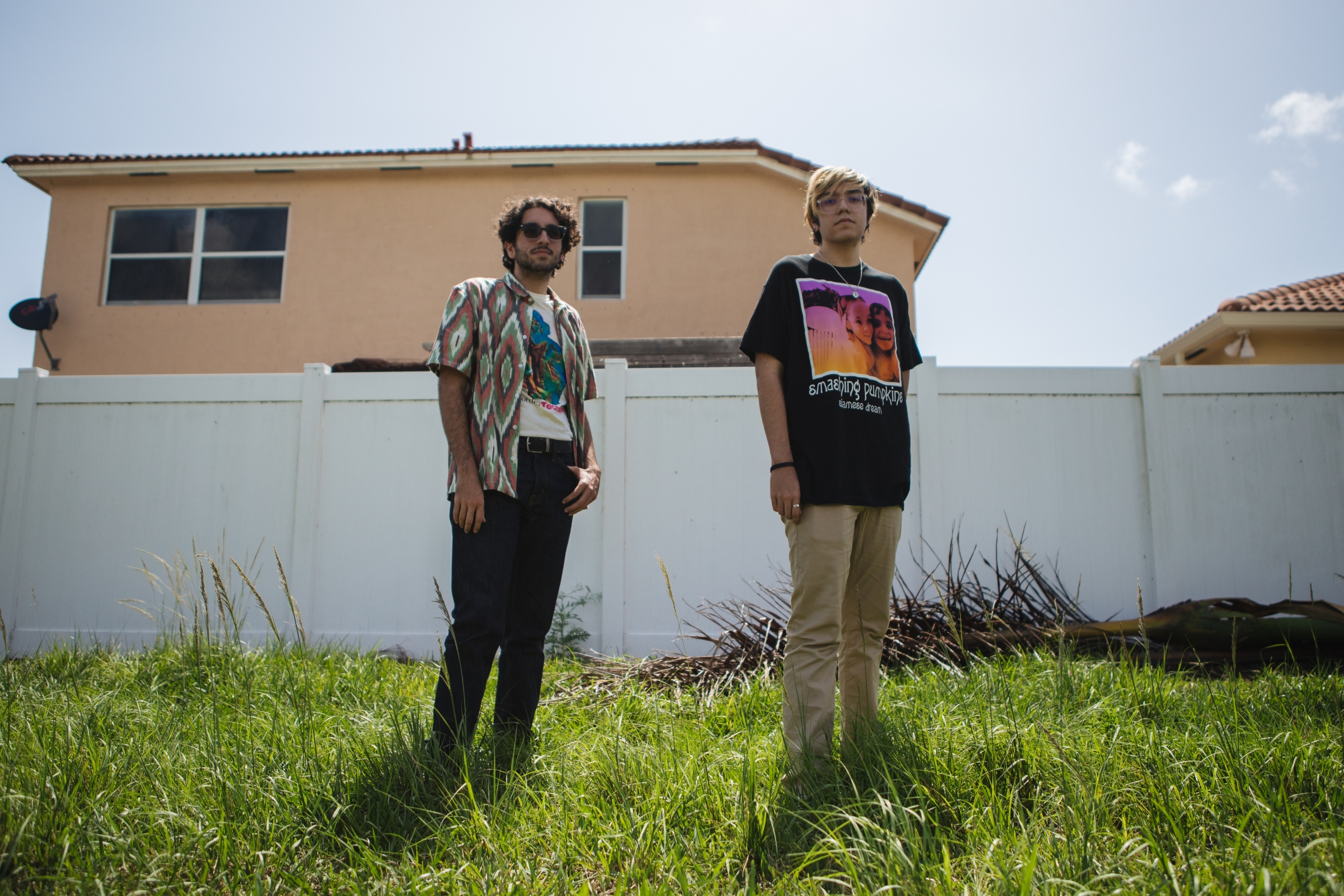 Tristan, left, and Jacob Cuenca in their neighborhood in Homestead, Florida, on May 21, 2020.