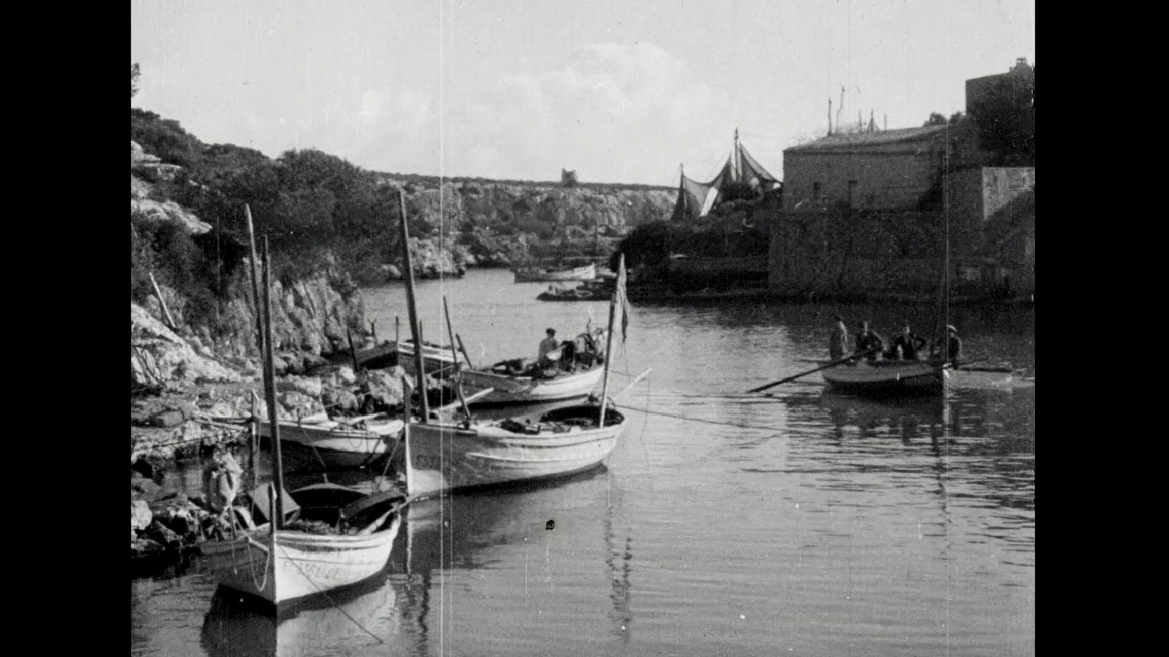 A seaside image of boats in Mallorca in black and white
