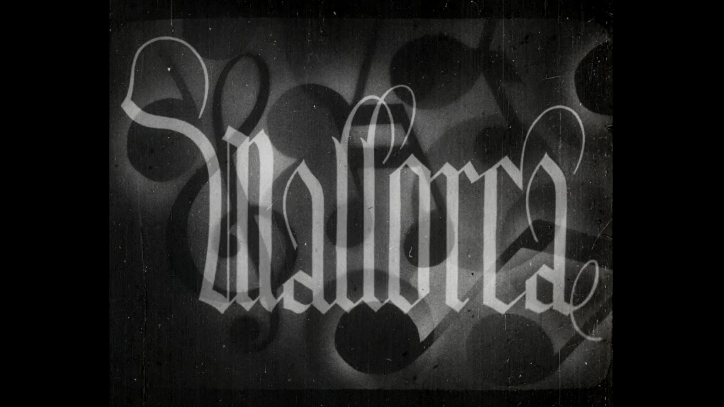 The word Mallorca in gothic lettering in black and white