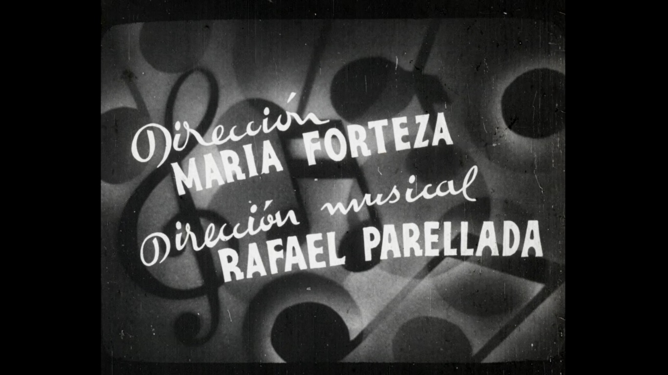 A screenshot of an old black and white film credit