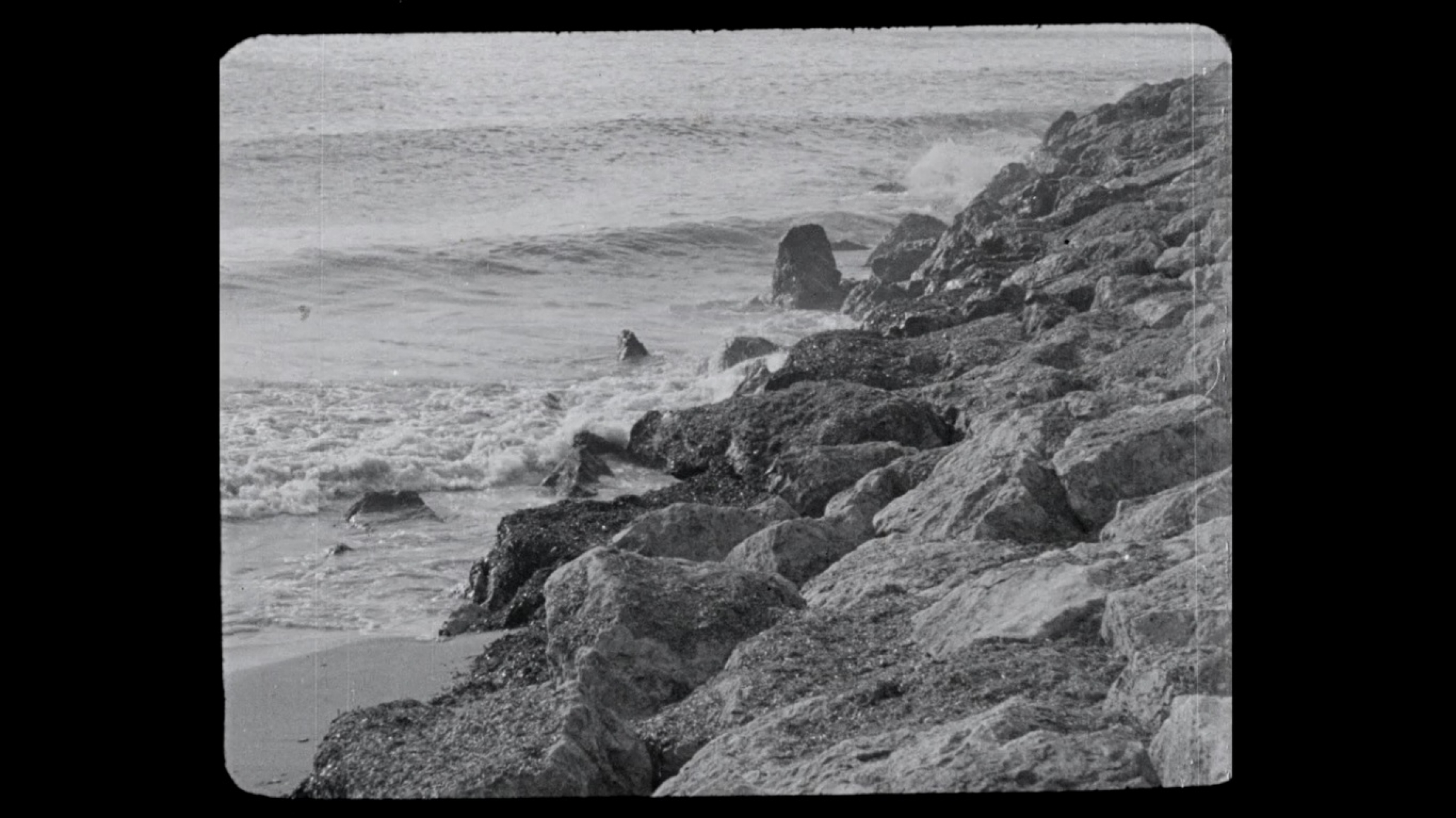 A seaside image from a black and white film.