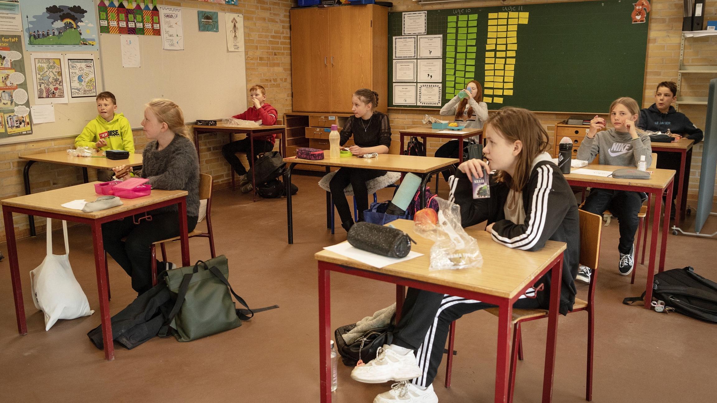 Pupils are seen during lunch break at the Korshoejskolen school, after it reopened following the lockdown due to the coronavirus disease (COVID-19) spread, in Randers,Denmark, April 15, 2020.