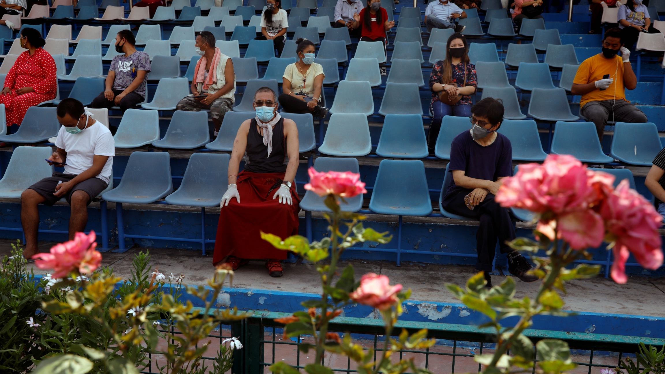 Stranded residents of Ladakh, a union territory in India, wait in a stadium for being thermal screened before taking buses back to Ladakh, after few restrictions were lifted by Delhi government during an extended nationwide lockdown to slow the spread of