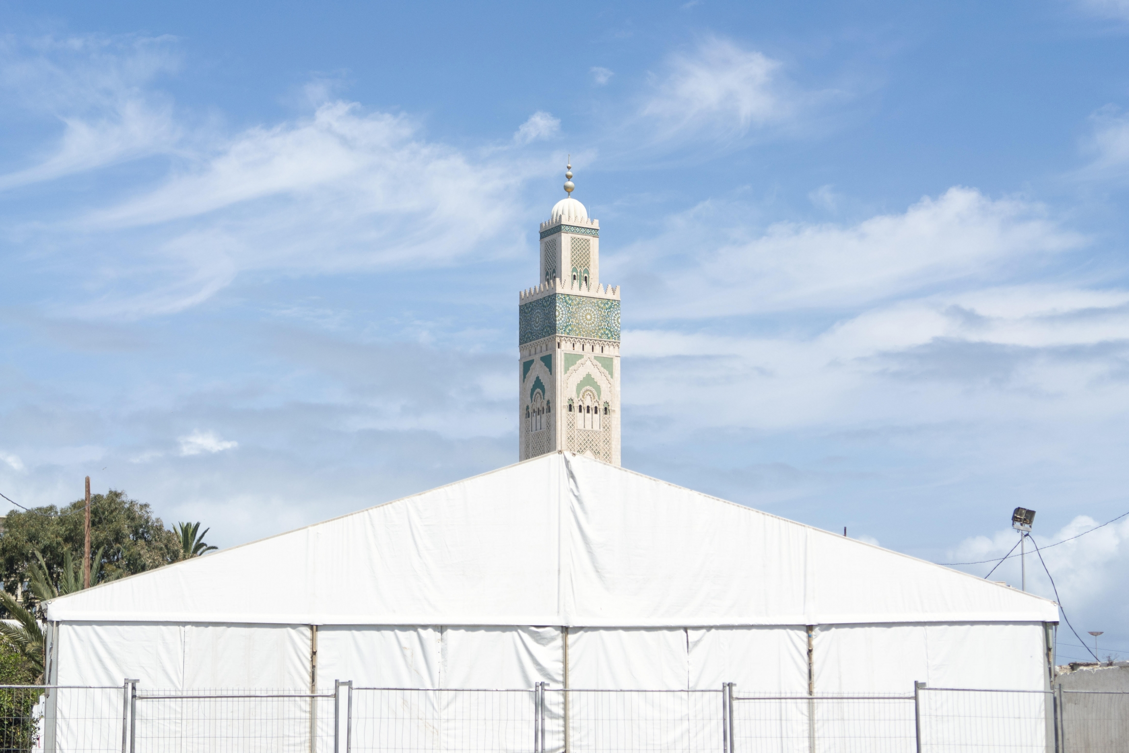 Authorities erected this tent for homeless people needing services during the lockdown. Behind it rises the minaret of the Hassan II mosque, which is now closed. Usually, Hassan II, Africa's biggest mosque, gets as many as 200,000 worshipers nightly durin