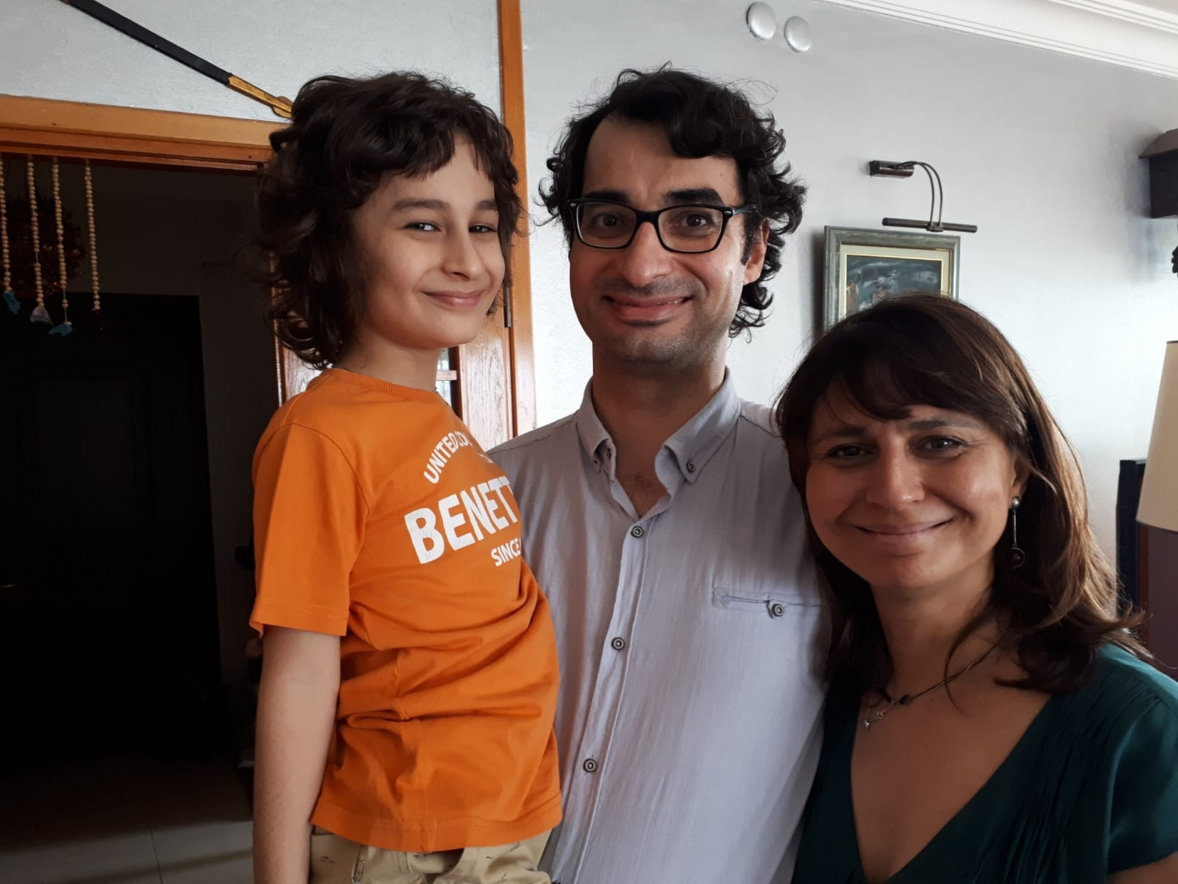 Özge Terkoğlu and her husband, Barış Terkoğlu, are pictured with their young son.