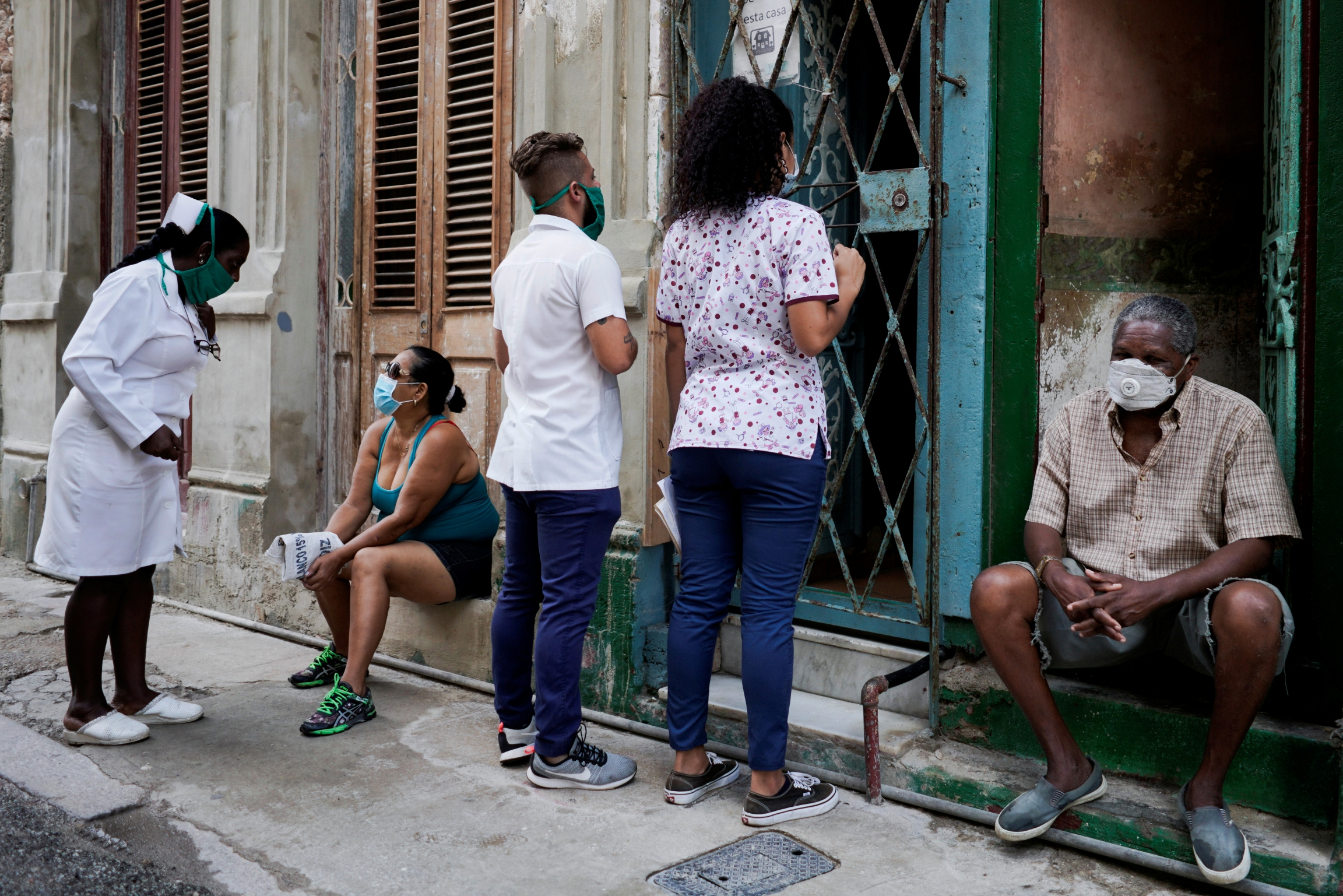 Medical students check door-to-door for people with symptoms amid concerns about the spread of the coronavirus disease (COVID-19), in downtown Havana, Cuba, May 11, 2020.